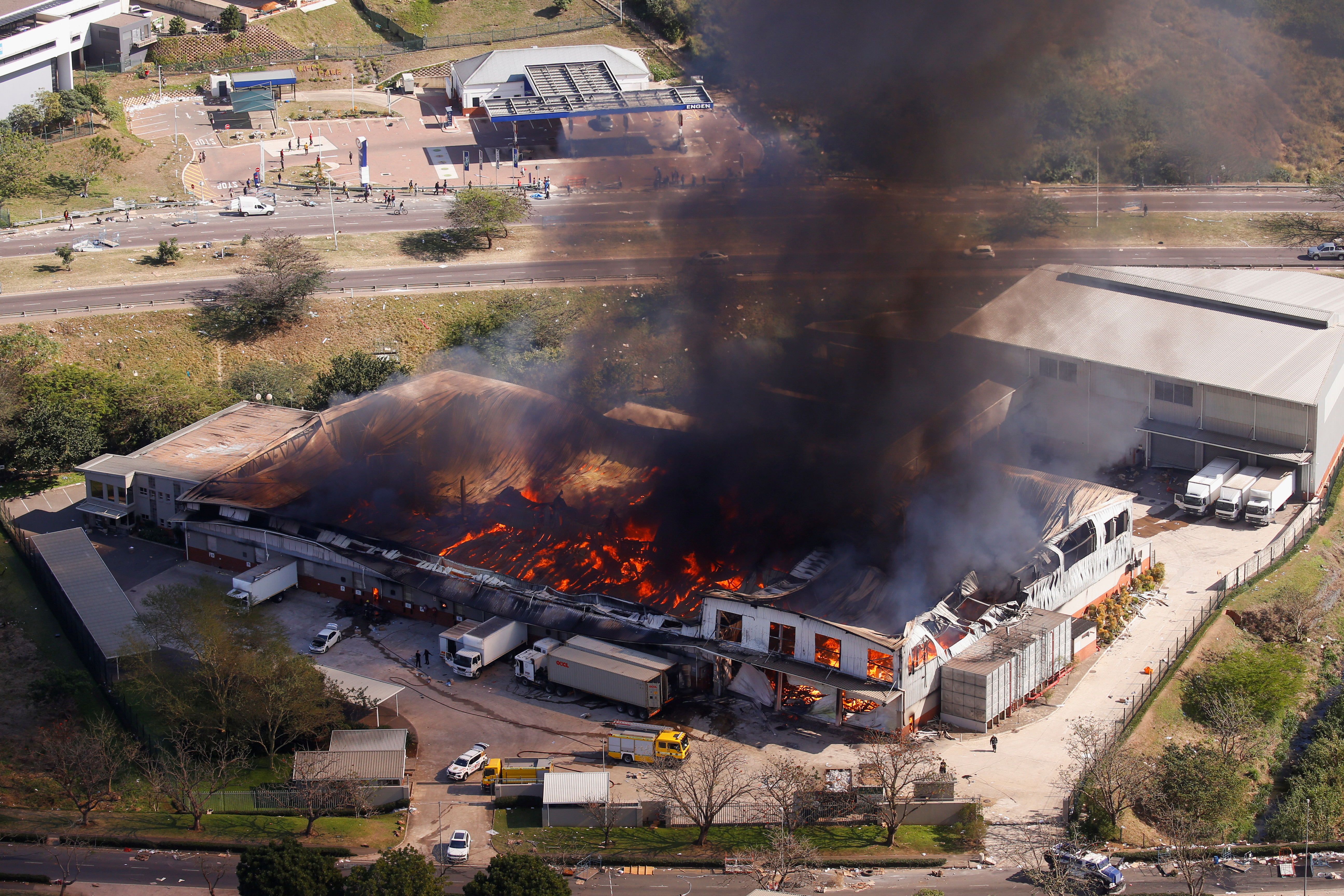 A general view of a burning warehouse after violence erupted following the jailing of former South African President Jacob Zuma, in Durban, South Africa, July 14, 2021. REUTERS/Rogan Ward
