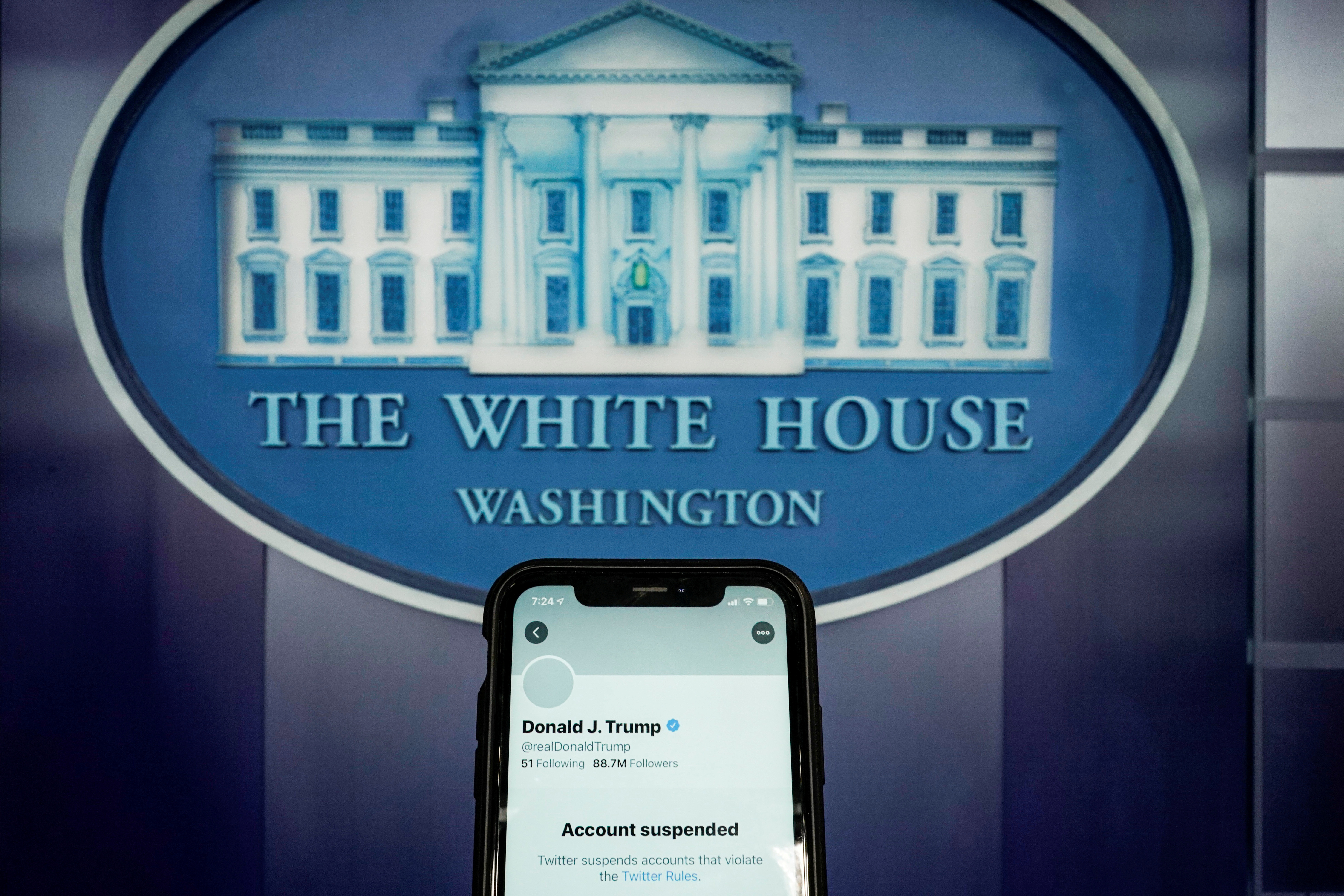 A photo illustration shows the suspended Twitter account of former U.S. President Donald Trump on a smartphone at the White House briefing room in Washington, U.S., January 8, 2021.  REUTERS/Joshua Roberts/Illustration/File Photo