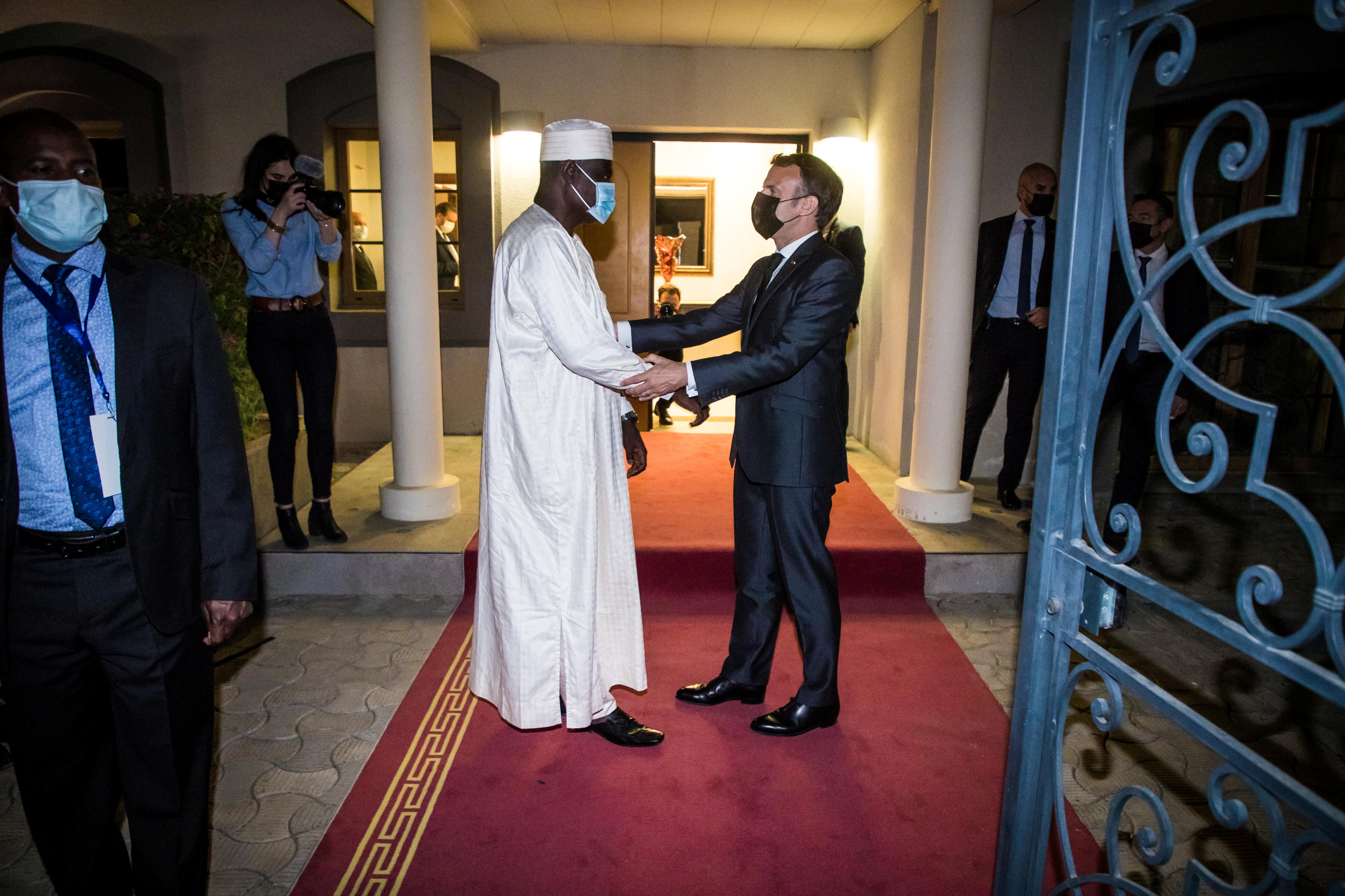 French President Emmanuel Macron greets Chairman of the African Union Commission Moussa Faki Mahamat after a meeting with African leaders of the Sahel countries as part of the funerals of Chad's President Idriss Deby in N'Djamena, Chad, April 22, 2021. Christophe Petit Tesson/Pool via REUTERS