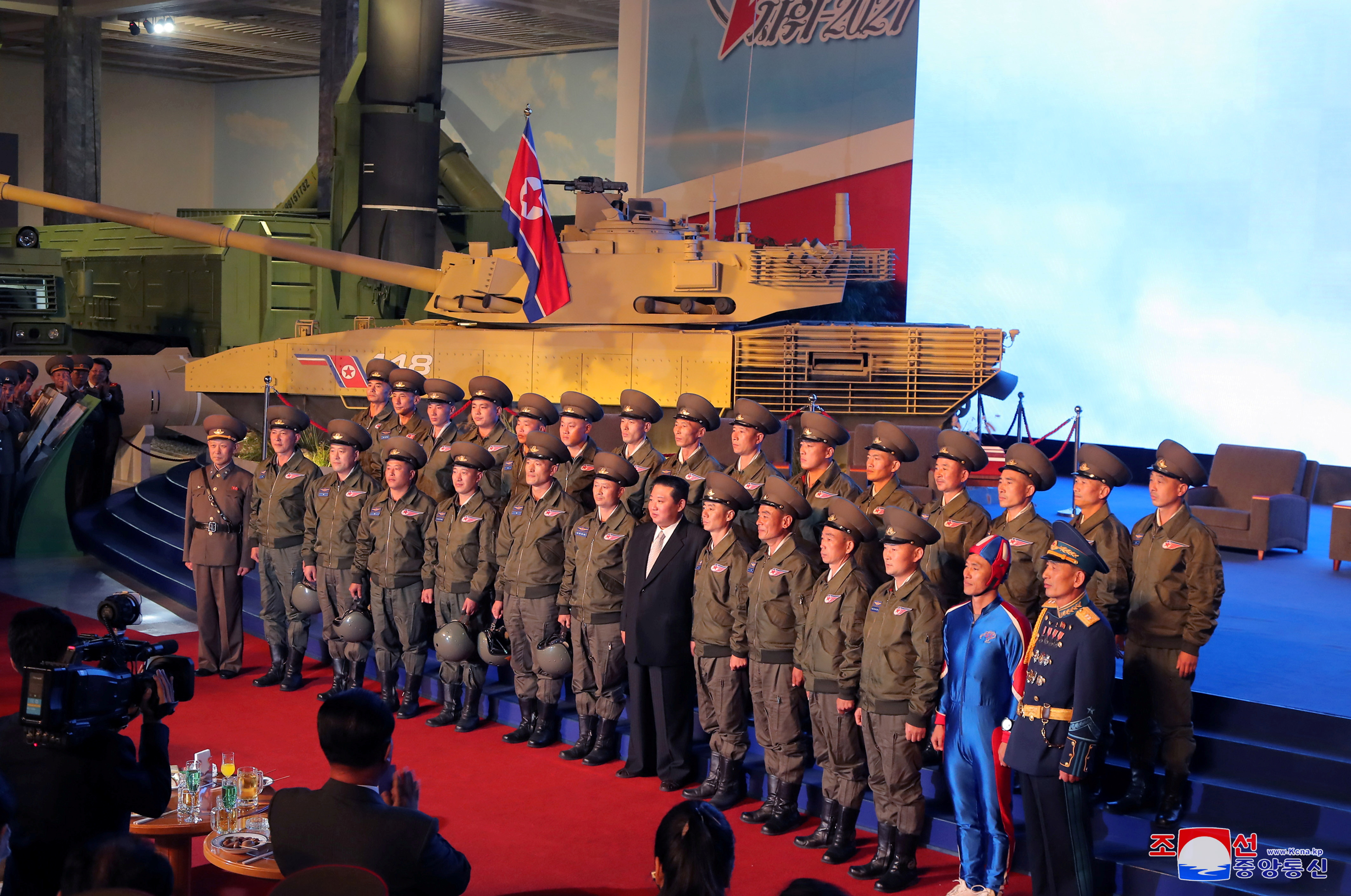North Korea's leader Kim Jong Un takes pictures with military personnel at the Defence Development Exhibition, in Pyongyang, North Korea, in this undated photo released on October 12, 2021 by North Korea's Korean Central News Agency (KCNA).  KCNA via REUTERS