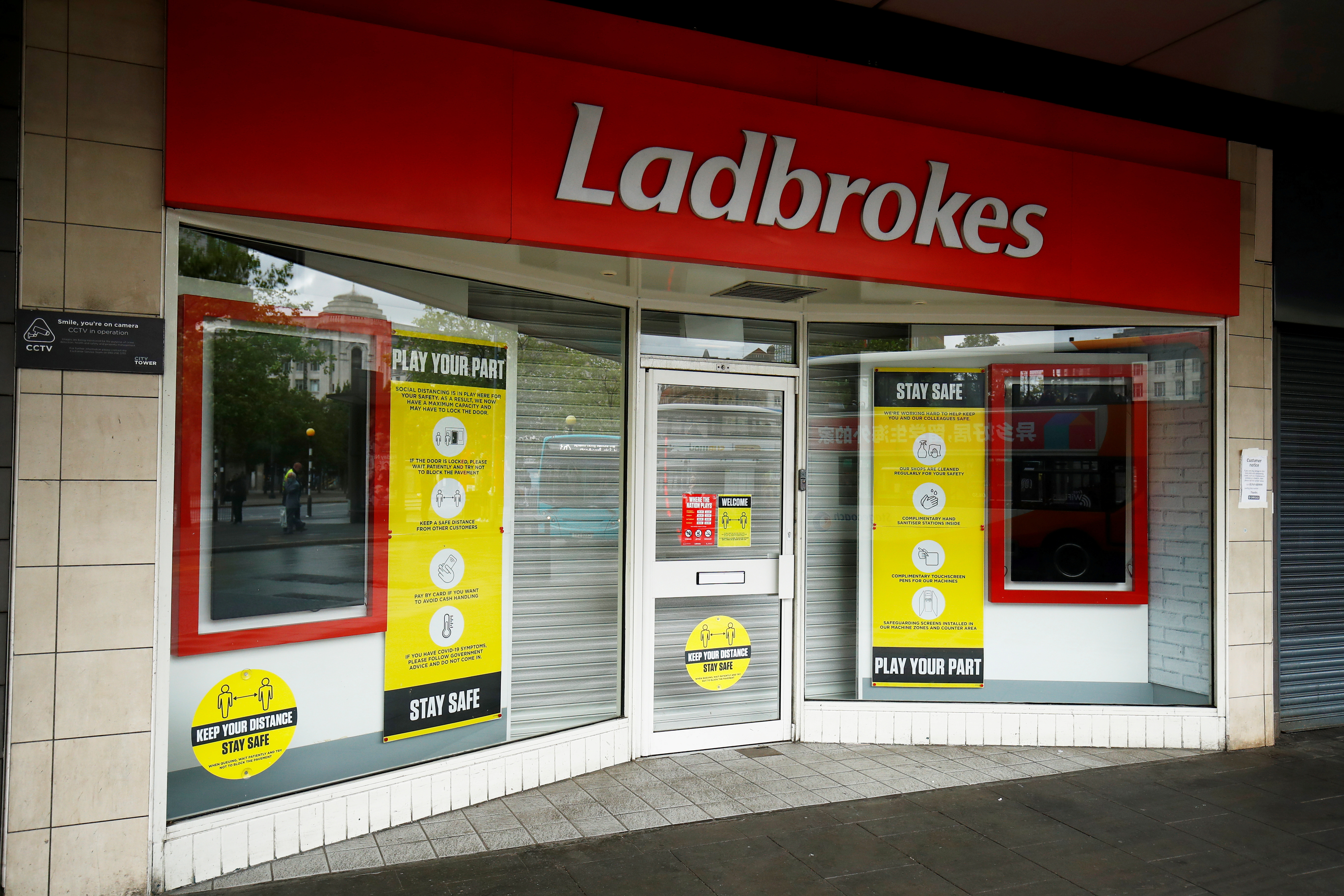 A closed Ladbrokes is seen in Manchester, following the outbreak of the coronavirus disease (COVID-19), Manchester, Britain, June 12, 2020. REUTERS/Jason Cairnduff/File Photo