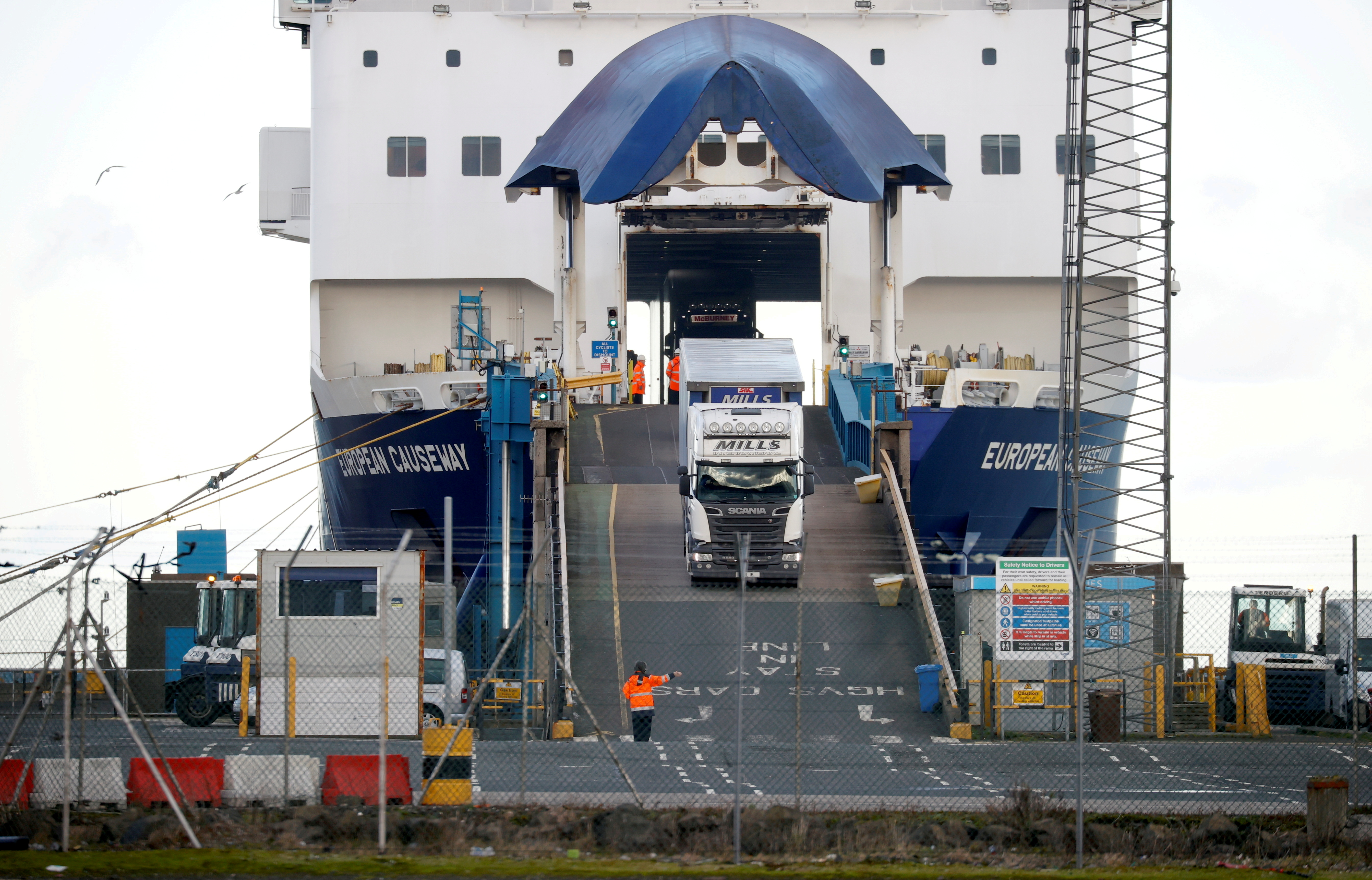 Lorries leave a ferry at the Port of Larne, Northern Ireland Britain January 1, 2021. REUTERS/Phil Noble/File Photo