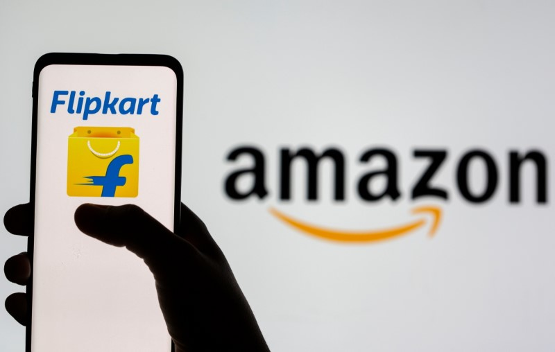 Smartphone with Flipkart logo is seen in front of displayed Amazon logo in this illustration taken, July 30, 2021. REUTERS/Dado Ruvic/Illustration