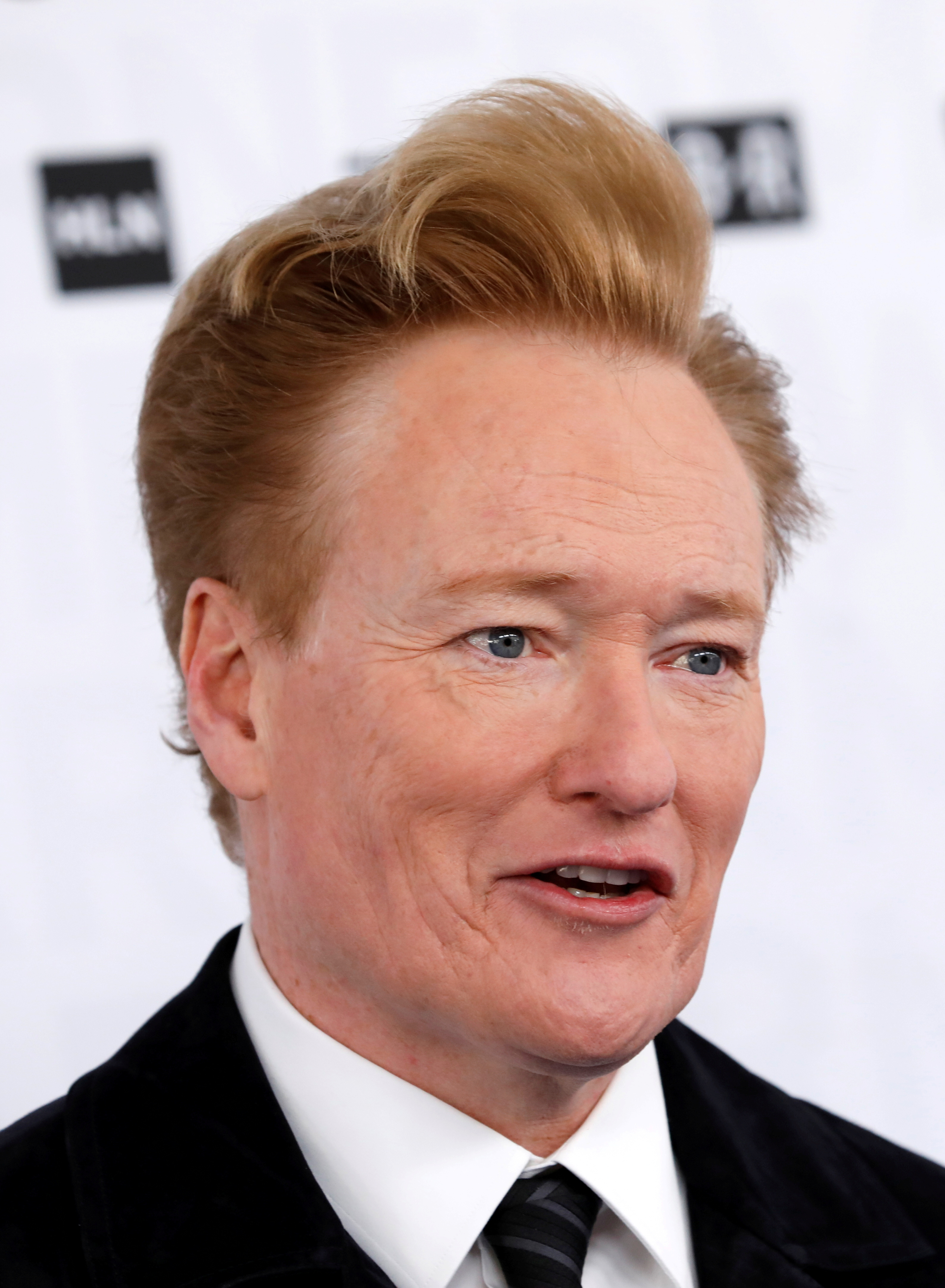 Comedian Conan O'Brien poses as he arrives at the WarnerMedia Upfront event in New York City, New York, U.S., May 15, 2019. REUTERS/Mike Segar