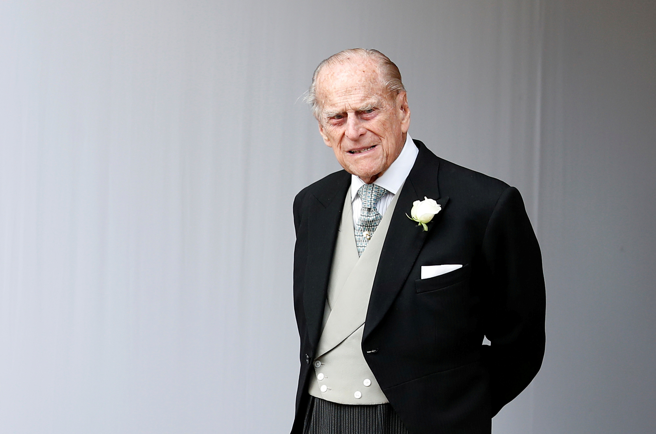 Britain's Prince Philip waits for the bridal procession following the wedding of Princess Eugenie of York and Jack Brooksbank in St George's Chapel, Windsor Castle, near London, Britain October 12, 2018. Alastair Grant/Pool via REUTERS/File Photo