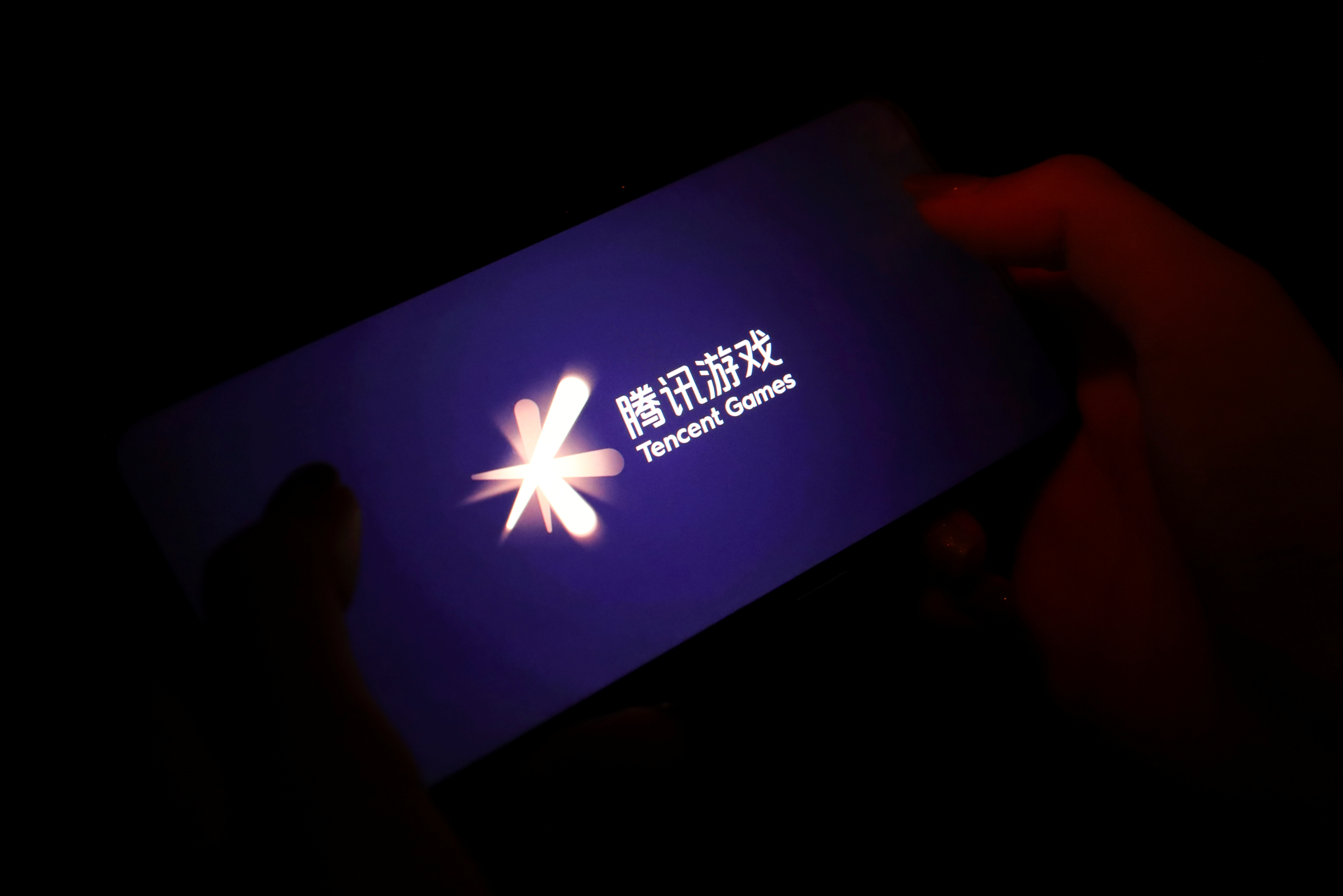 The Tencent Games logo is seen on its game on a mobile phone in this illustration picture taken August 3, 2021. REUTERS/Florence Lo/Illustration