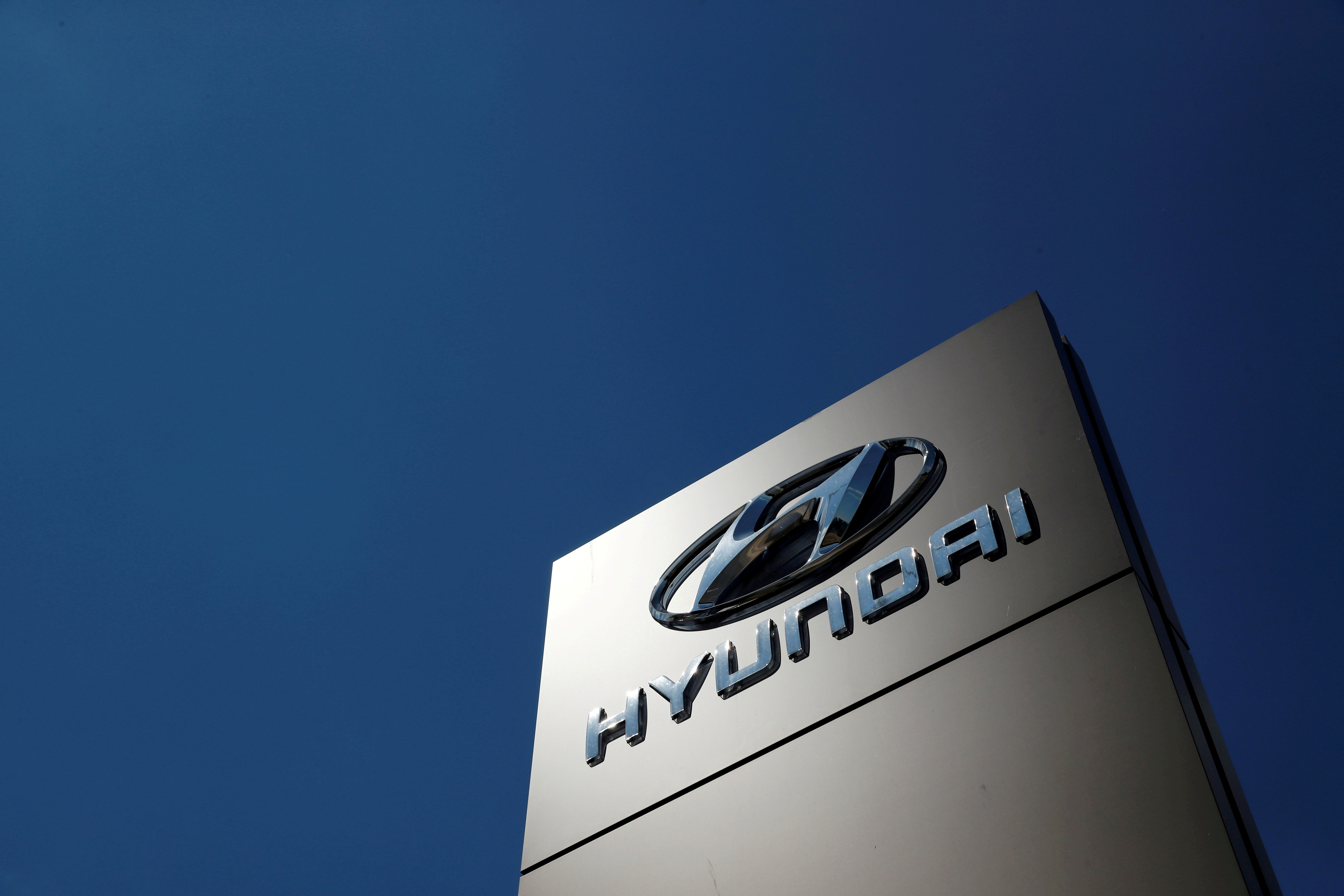 A shop sign of Hyundai is seen outside a car showroom in Bletchley, Milton Keynes, Britain, May 31, 2020. REUTERS/Andrew Boyers/File Photo