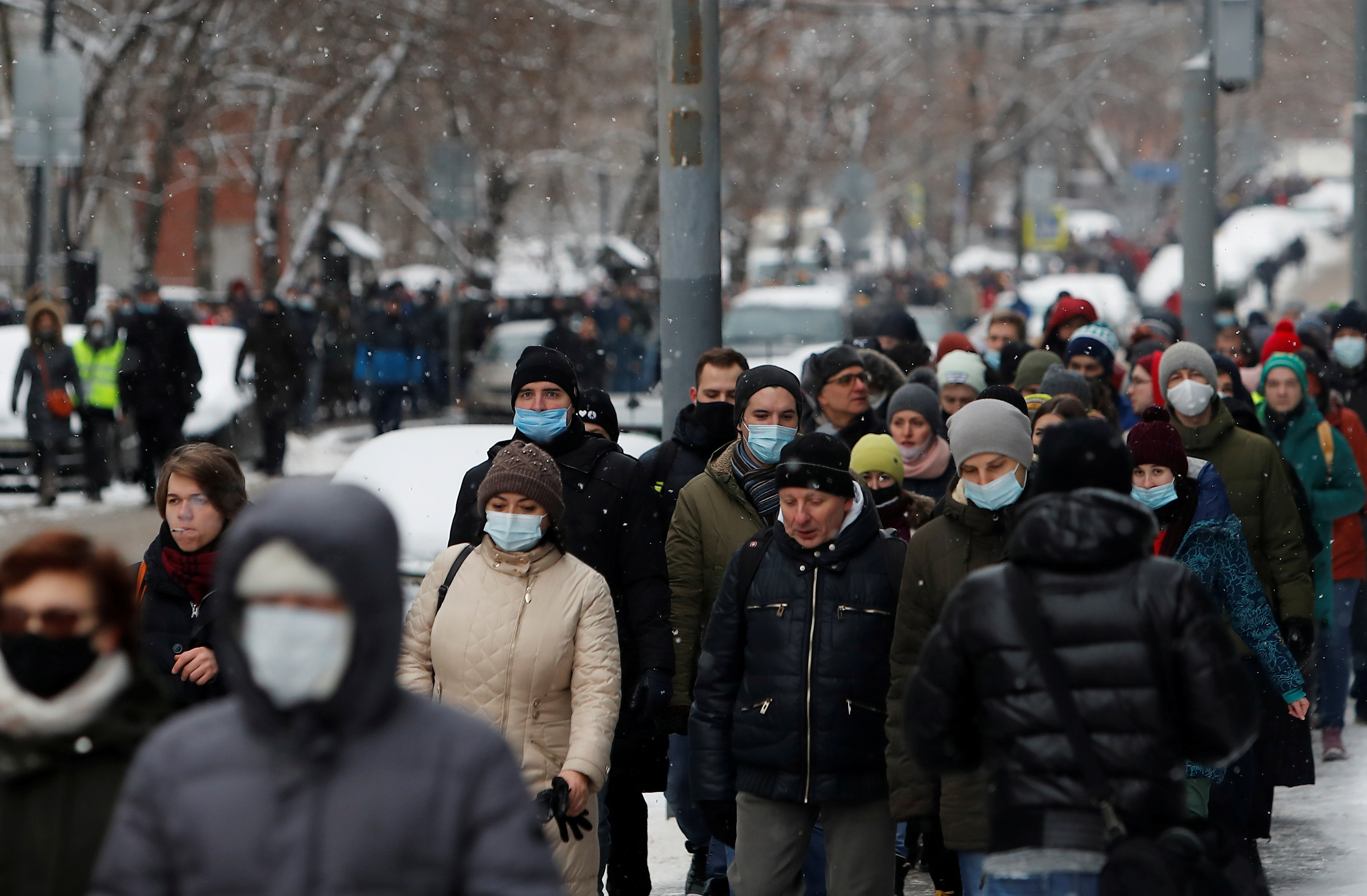 People walk on a street during a rally in support of jailed Russian opposition leader Alexei Navalny in Moscow, Russia January 31, 2021. REUTERS/Maxim Shemetov