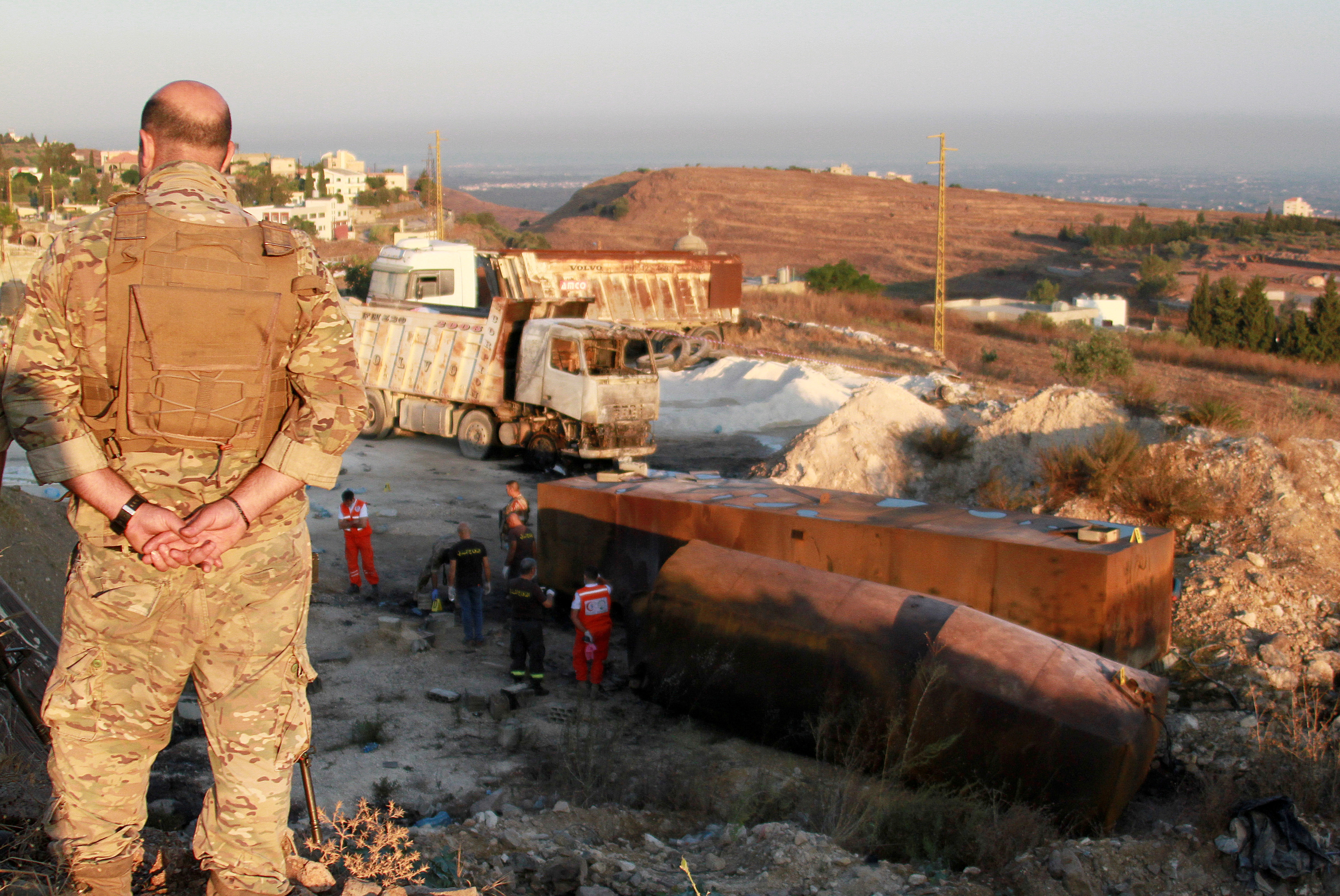 A Lebanese army soldier stands guard near the site of a fuel tank explosion in Akkar, in northern Lebanon, August 15, 2021. REUTERS/Omar Ibrahim