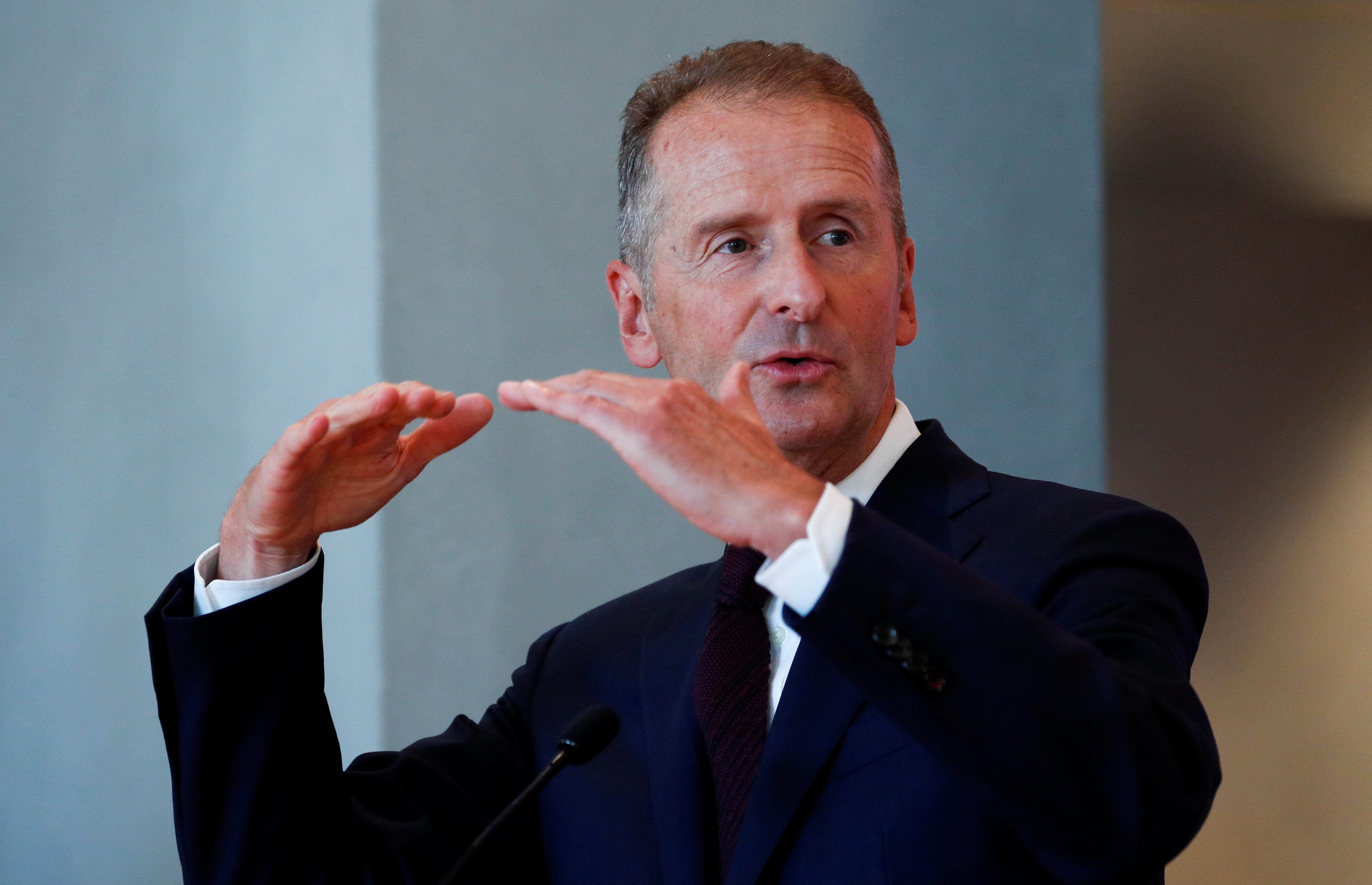 Volkswagen Group Chief Executive Officer Herbert Diess gestures as he speaks during a news conference to announce the appointment of Wayne Griffiths as the new president of Volkswagen's Spanish brand SEAT, in Barcelona, Spain September 23, 2020. REUTERS/Albert Gea