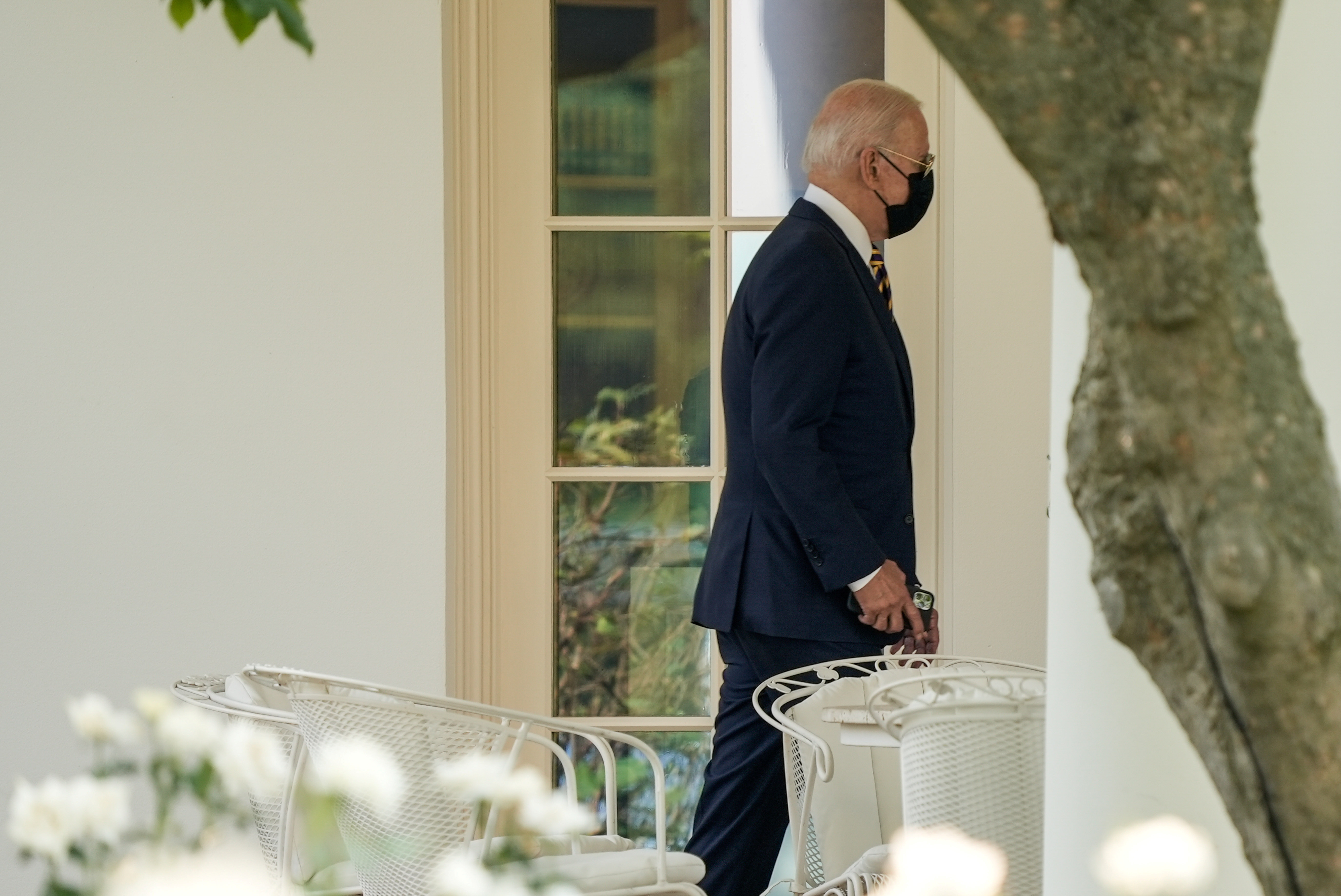 U.S. President Joe Biden returns from Lower Macungie Township, Pennsylvania and walks across the South Lawn to the Oval Office in Washington, D.C., U.S. July 28, 2021. REUTERS/Ken Cedeno