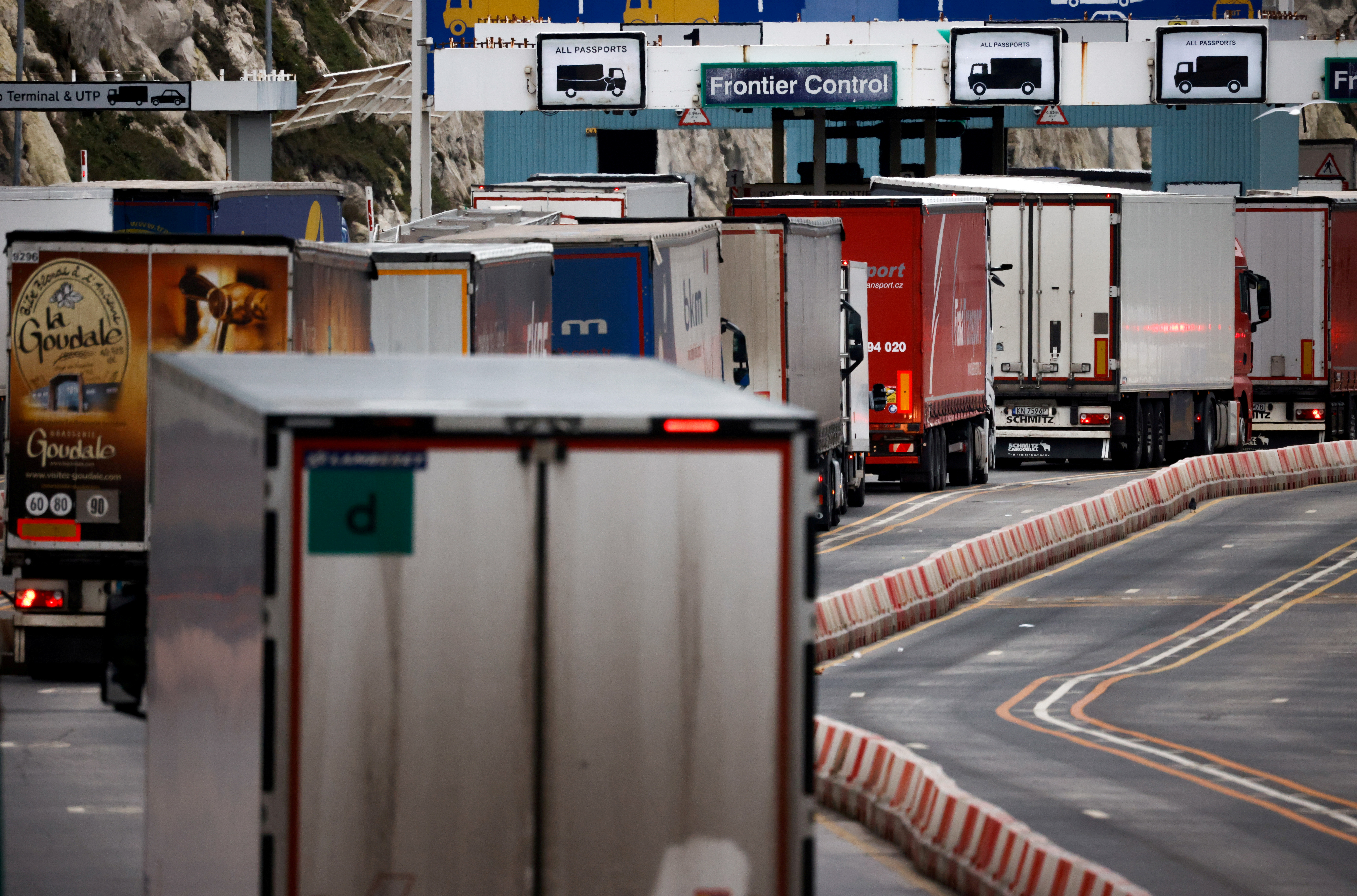 Lorries queue in at the border control of the Port of Dover in Dover, Britain, January 15, 2021. REUTERS/John Sibley/File Photo