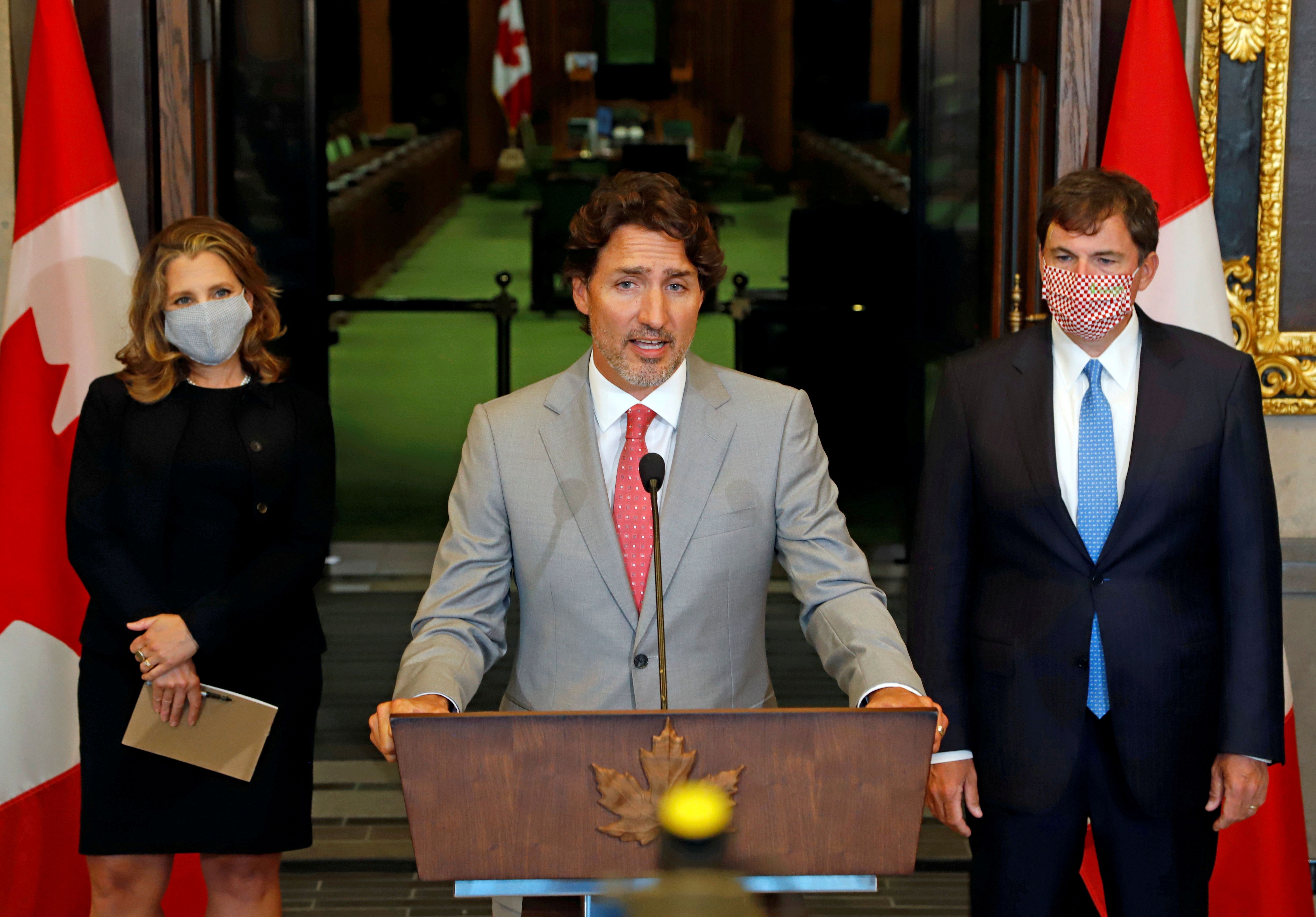 Canadian Prime Minister Justin Trudeau speaks to reporters next to Canadian Deputy Prime Minister and Finance Minister Chrystia Freeland and Minister of Intergovernmental Affairs Dominic LeBlanc on Parliament Hill in Ottawa, Ontario, Canada August 18, 2020. REUTERS/Patrick Doyle/File Photo