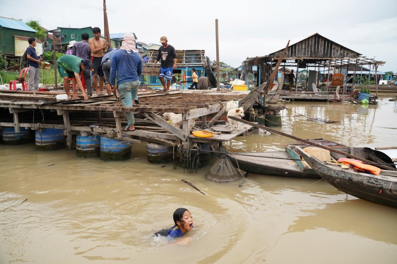 Residents demolish their floating houses on the Tonle Sap river after they were ordered to leave within one week of being notified by local authorities in Prek Pnov district, Phnom Penh, Cambodia, June 12, 2021. REUTERS/Cindy Liu