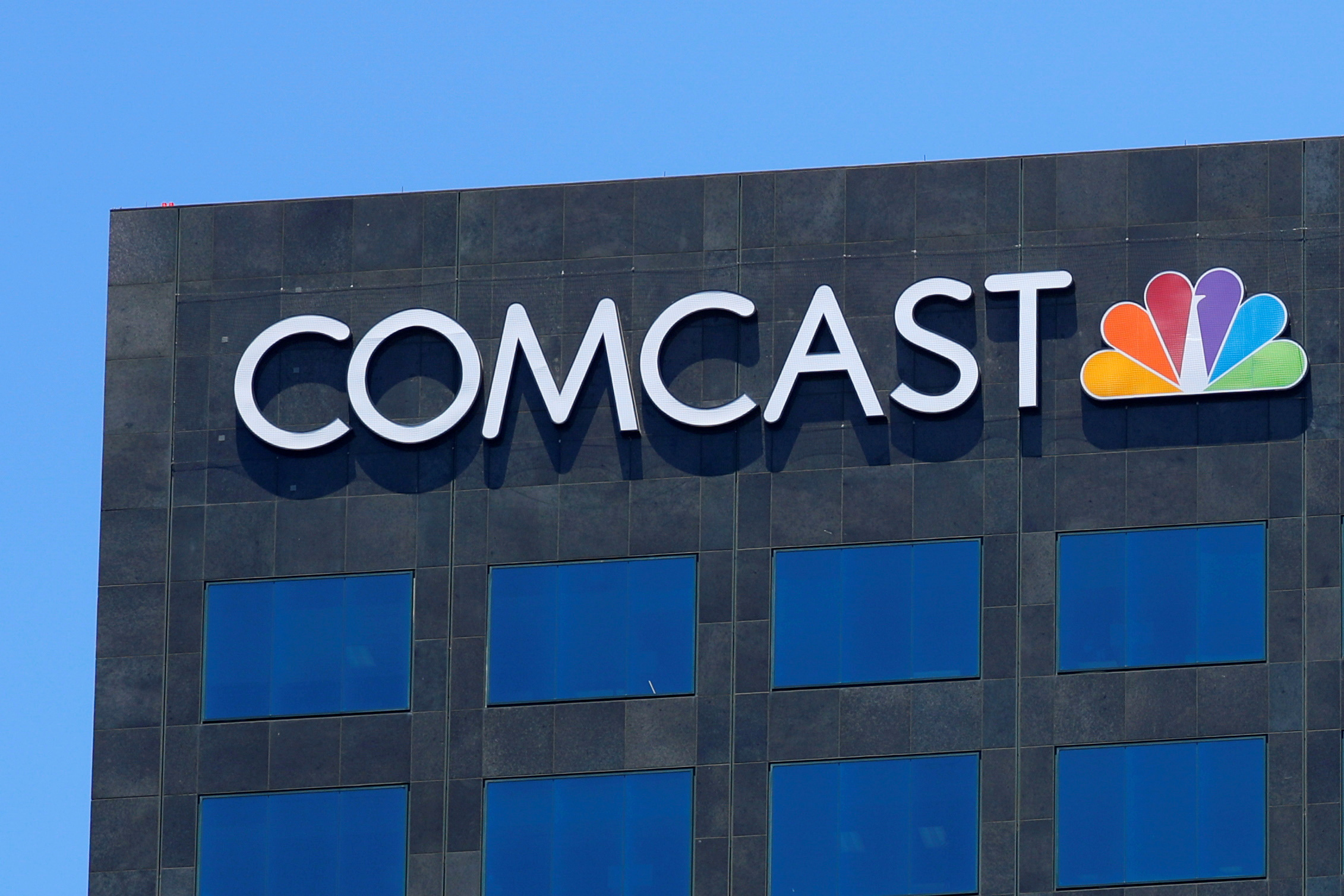 The Comcast NBC logo is shown on a building in Los Angeles, California, U.S. June 13, 2018.   REUTERS/Mike Blake/File Photo