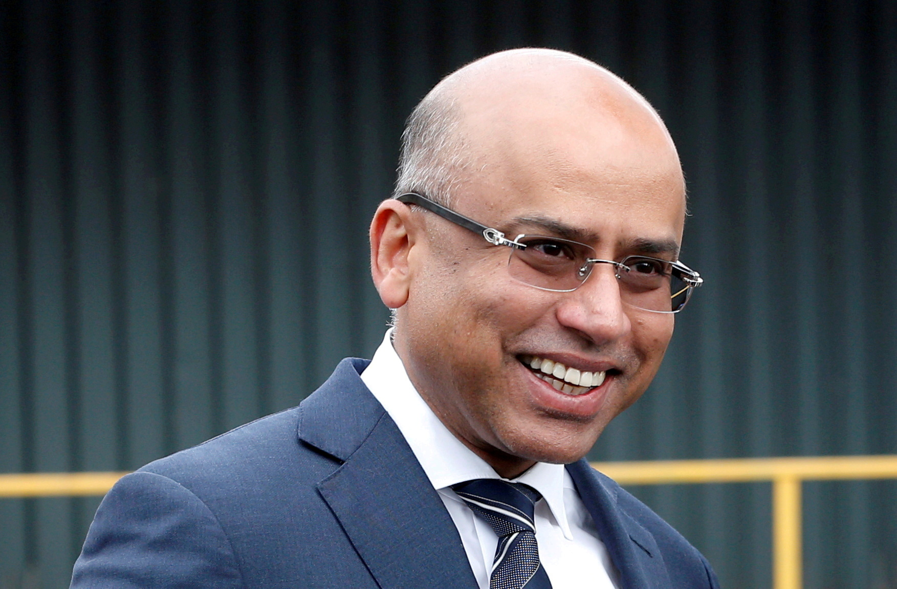 Liberty Steel's Sanjeev Gupta smiles outside the company's Liberty Steel processing mill in Dalzell, Scotland, Britain April 8, 2016. REUTERS/Russell Cheyne