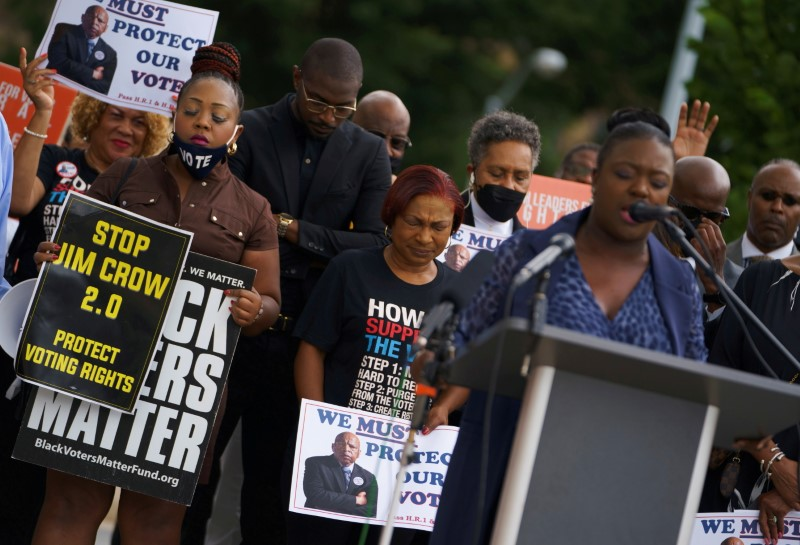 Faith leaders and protesters attend a rally against the state's new voting restrictions outside the Georgia State Capitol, in Atlanta, Georgia, U.S., June 8, 2021. REUTERS/Elijah Nouvelage/File Photo