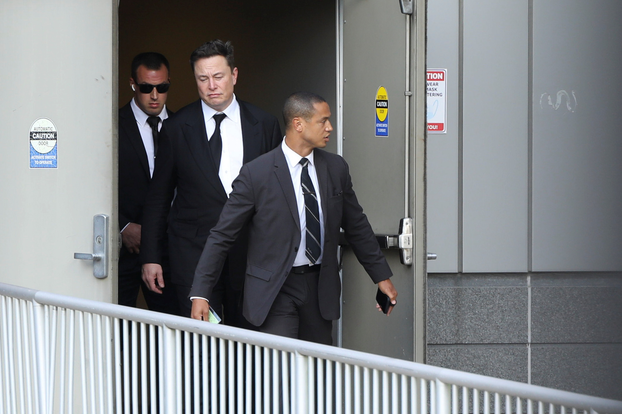 Tesla CEO Elon Musk departs the Williams Justice Center after taking the stand to defend Tesla Inc's 2016 deal for SolarCity in a case before the Delaware Court of Chancery in Wilmington, Delaware, U.S. July 12, 2021. REUTERS/Hannah Beier