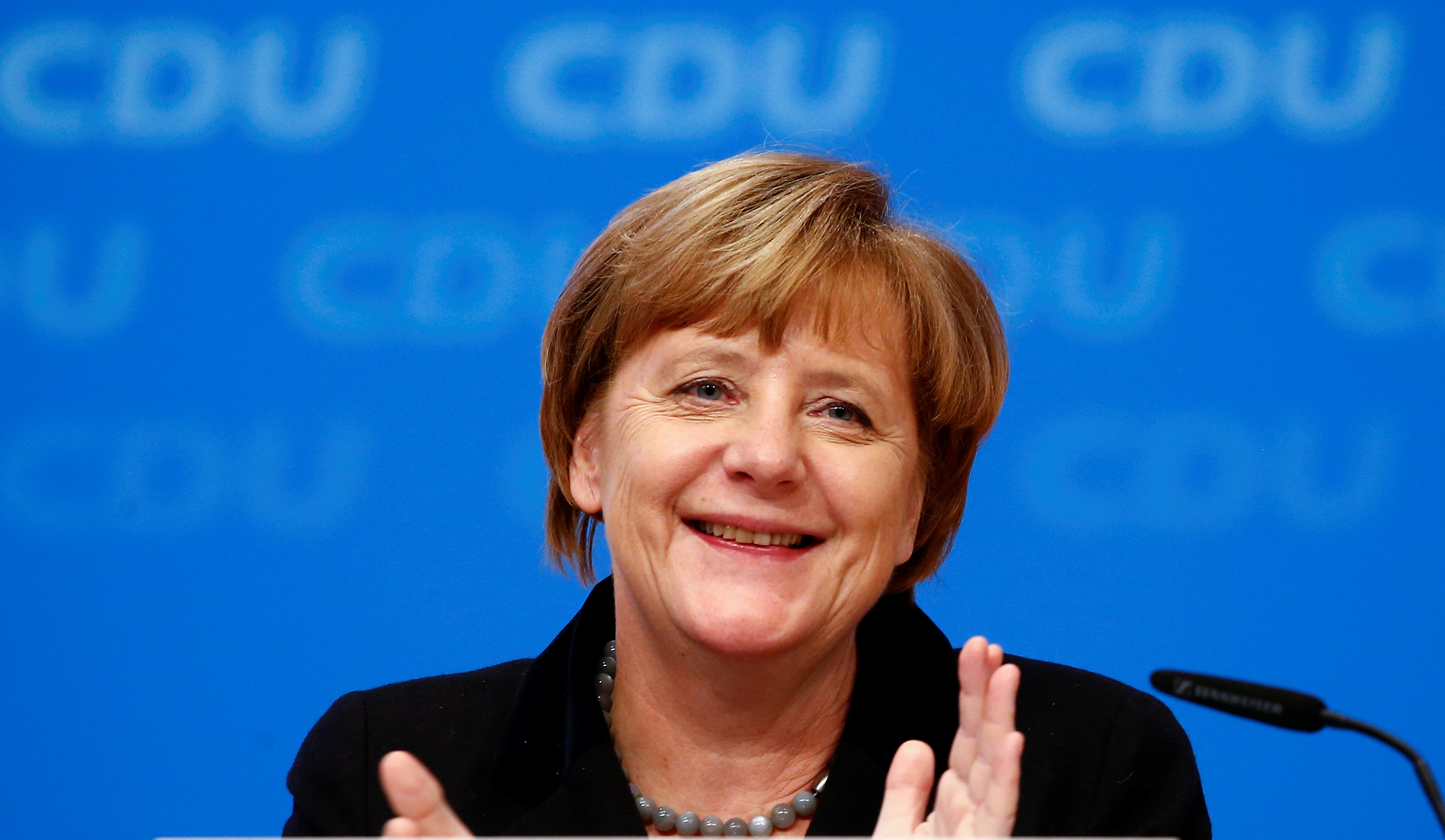 German Chancellor and leader of the Christian Democratic Union (CDU) Angela Merkel applauds after the overwhelming vote on a declaration about refugees during the CDU party congress in Karlsruhe, Germany December 14, 2015. REUTERS/Kai Pfaffenbach