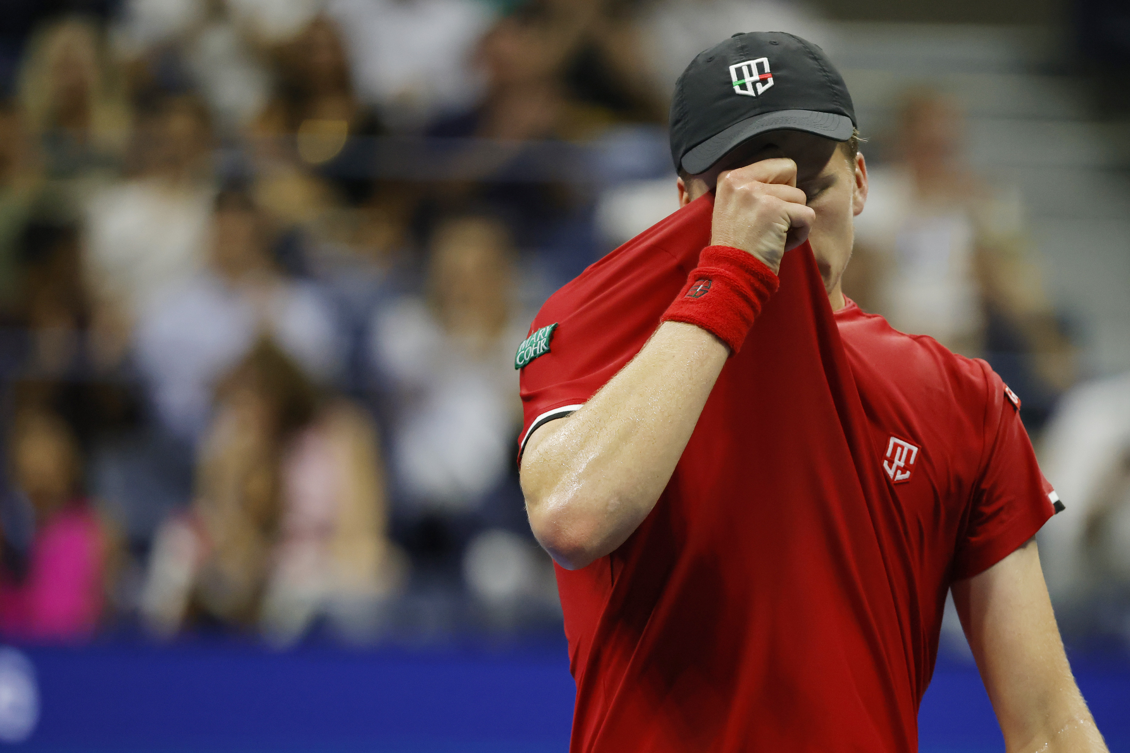 Sep 6, 2021; Flushing, NY, USA; Jenson Brooksby of the United States wipes his face between points against Novak Djokovic of Serbia (not pictured) on day eight of the 2021 U.S. Open tennis tournament at USTA Billie Jean King National Tennis Center. Mandatory Credit: Geoff Burke-USA TODAY Sports