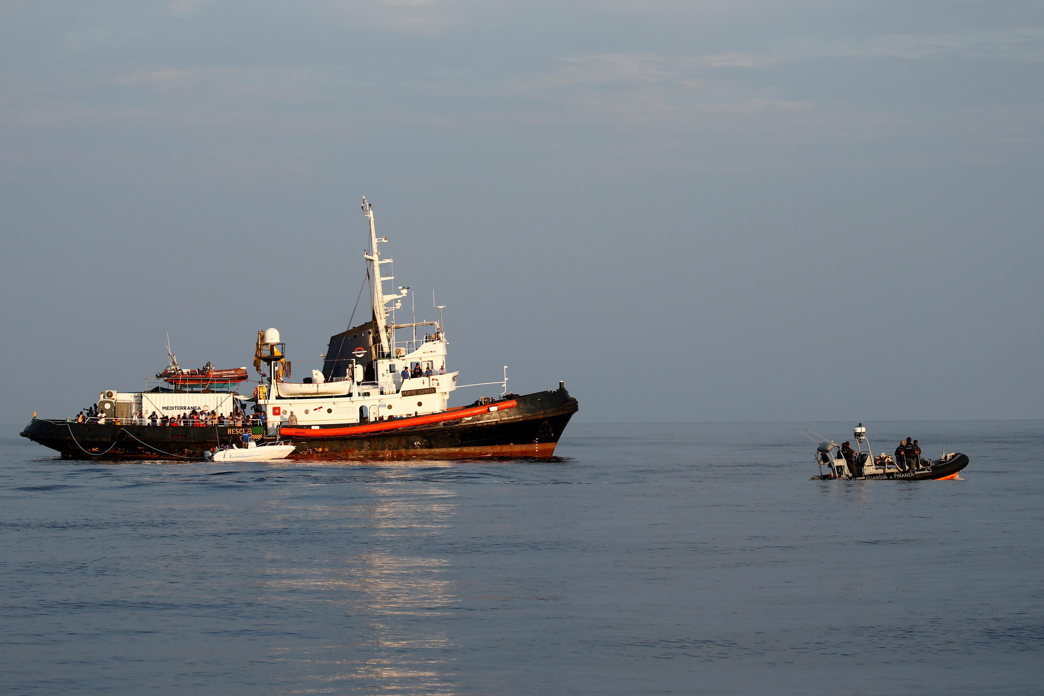A rigid-hulled inflatable boat (RHIB) of the Italian Finance Police patrols near the Mare Jonio, operated by Italian charity Mediterranea Saving Humans, and the German NGO Sea-Eye migrant rescue ship 'Alan Kurdi' (unseen).  REUTERS/Darrin Zammit Lupi