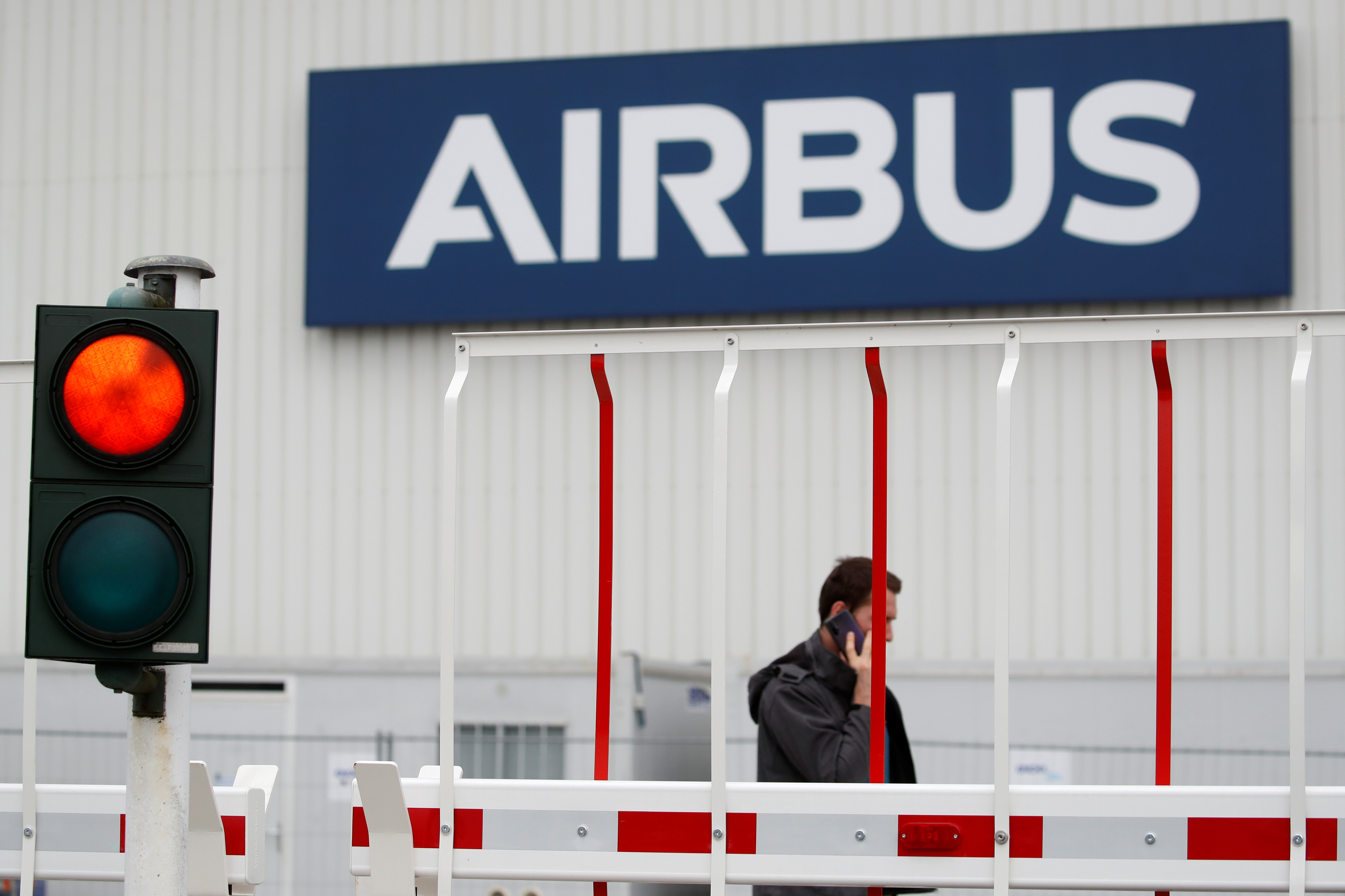 The logo of Airbus is pictured at the entrance of the Airbus facility in Bouguenais, near Nantes, France, July 2, 2020. REUTERS/Stephane Mahe