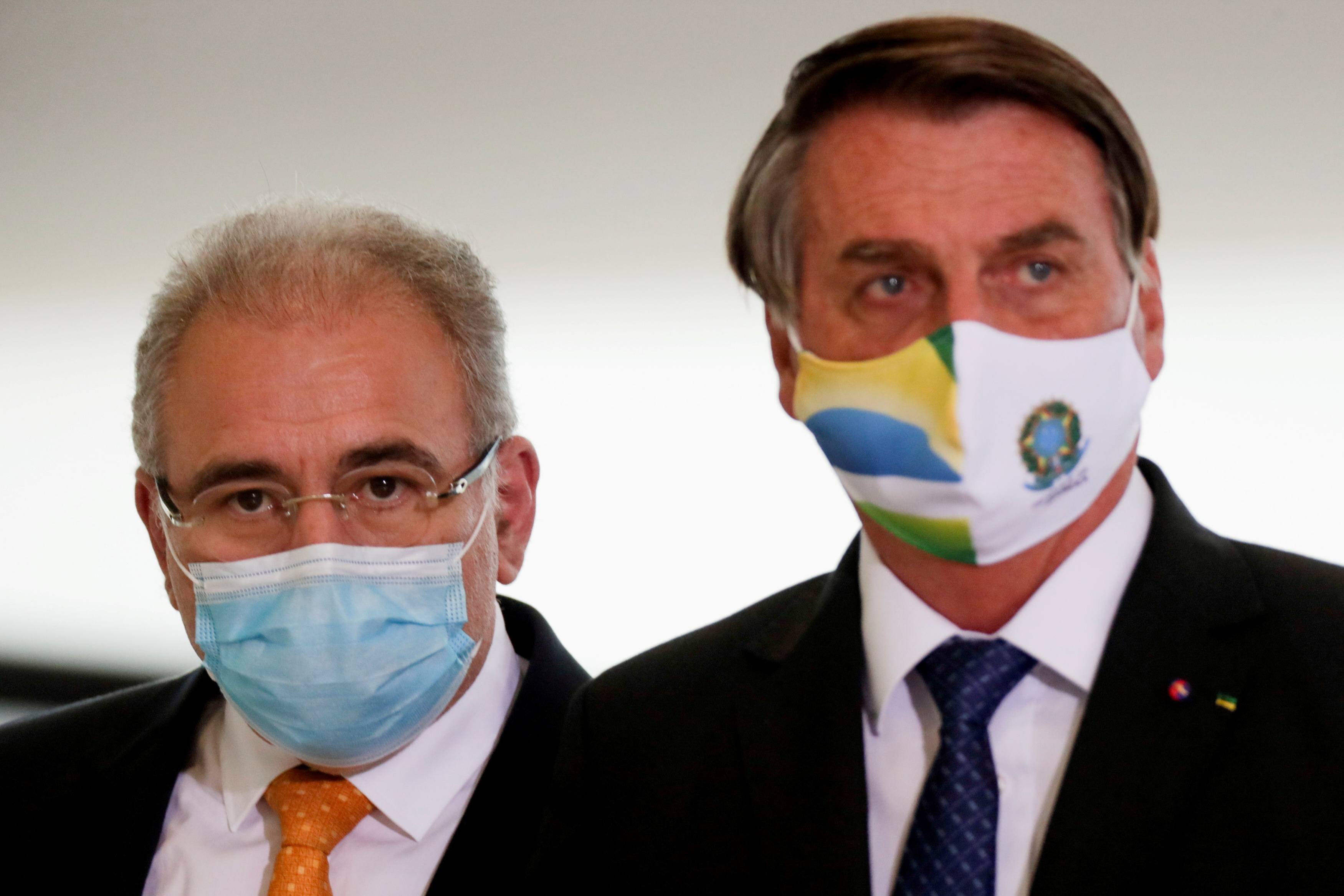 Brazil's Health Minister Marcelo Queiroga and Brazil's President Jair Bolsonaro arrive for a ceremony of release of resources for Primary Health Care in combat of the coronavirus disease (COVID-19), at the Planalto Palace in Brasilia, Brazil May 11, 2021. REUTERS/Ueslei Marcelino/File Photo