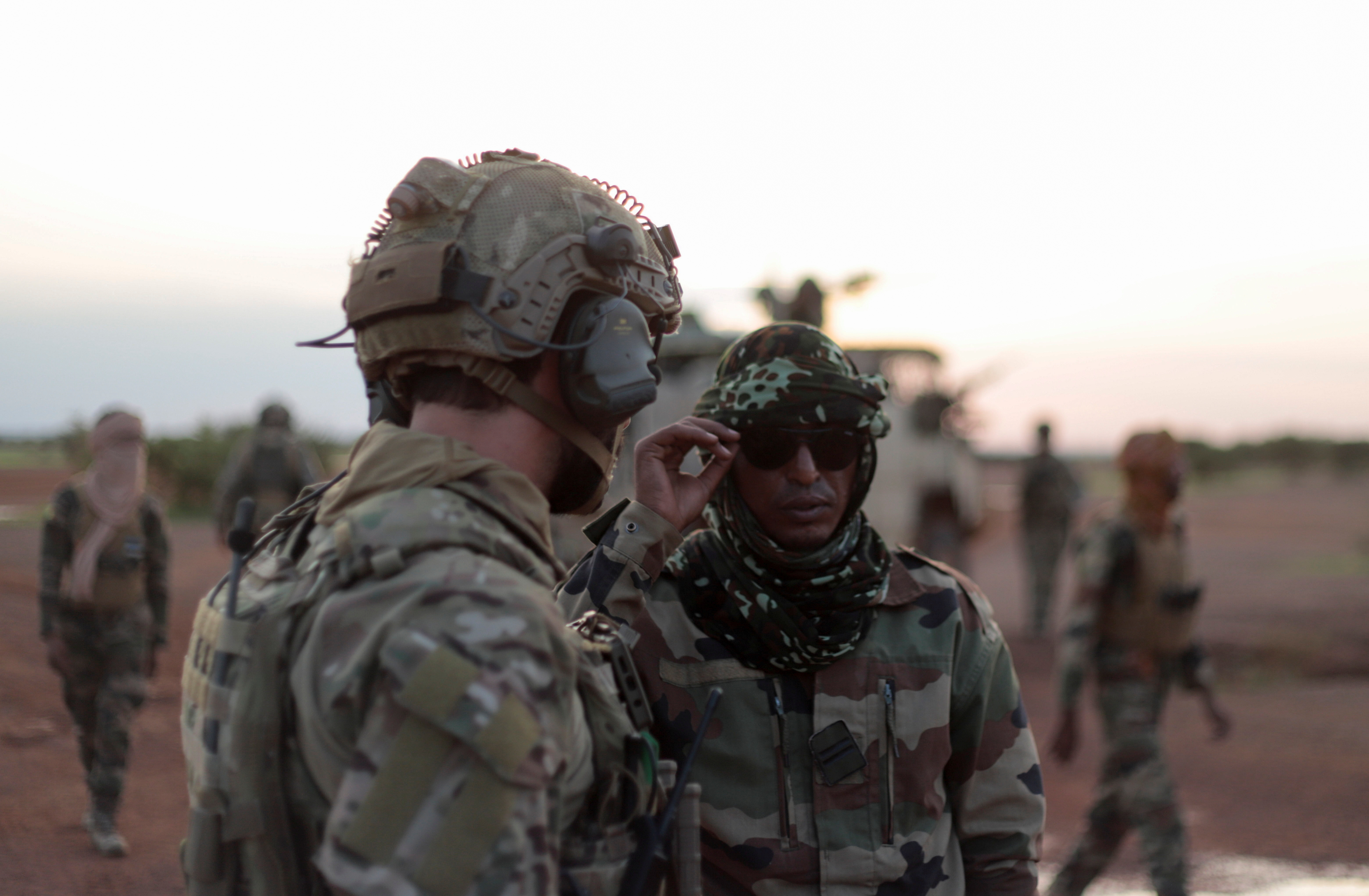 An officer from the new Takuba force talks with a Malian officer during a patrol near Niger border in Dansongo Circle, Mali August 23, 2021.  REUTERS/Paul Lorgerie