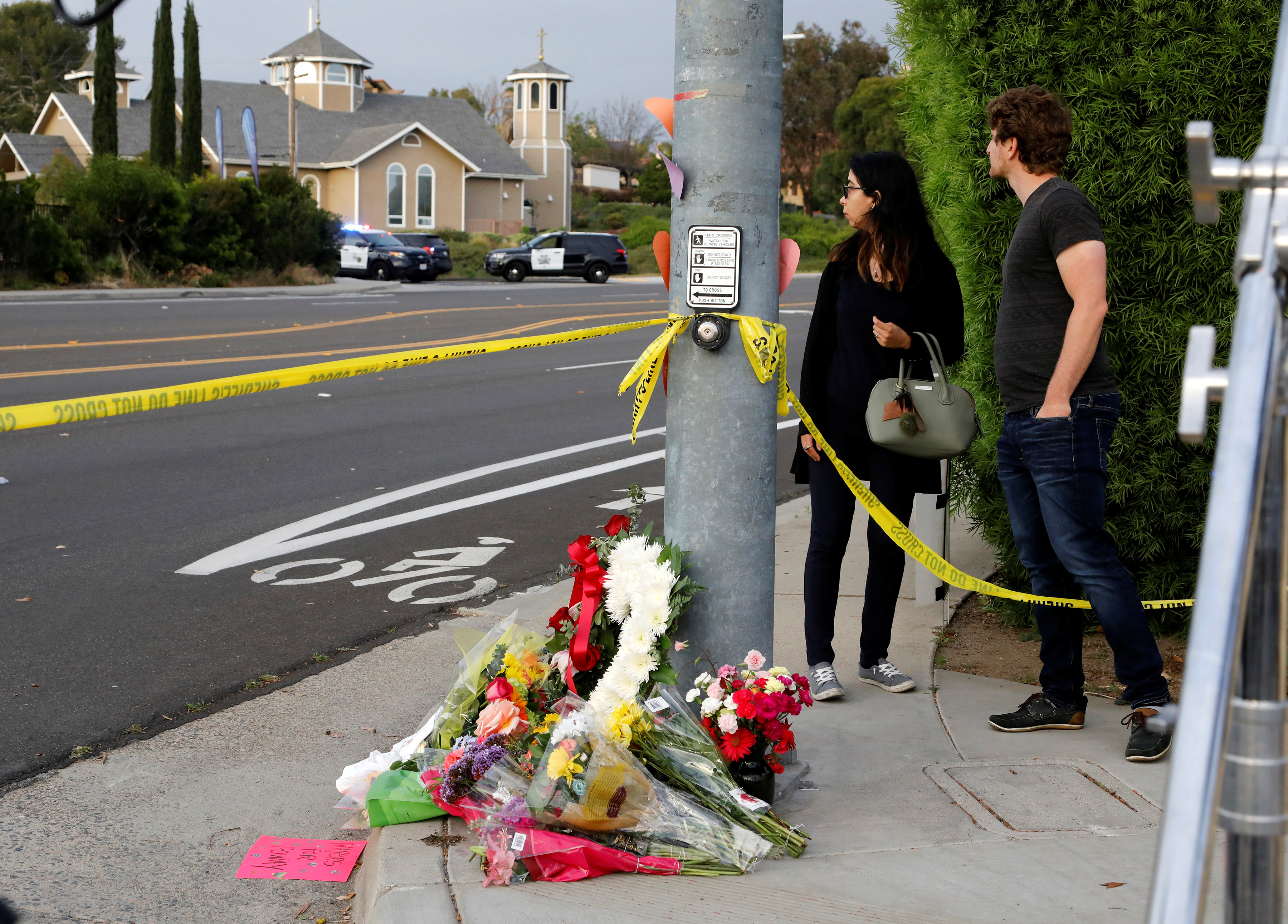 A makeshift memorial is placed by a light pole a block away from a shooting incident where one person was killed at the Congregation Chabad synagogue in Poway, north of San Diego, California, U.S. April 27, 2019. REUTERS/John Gastaldo