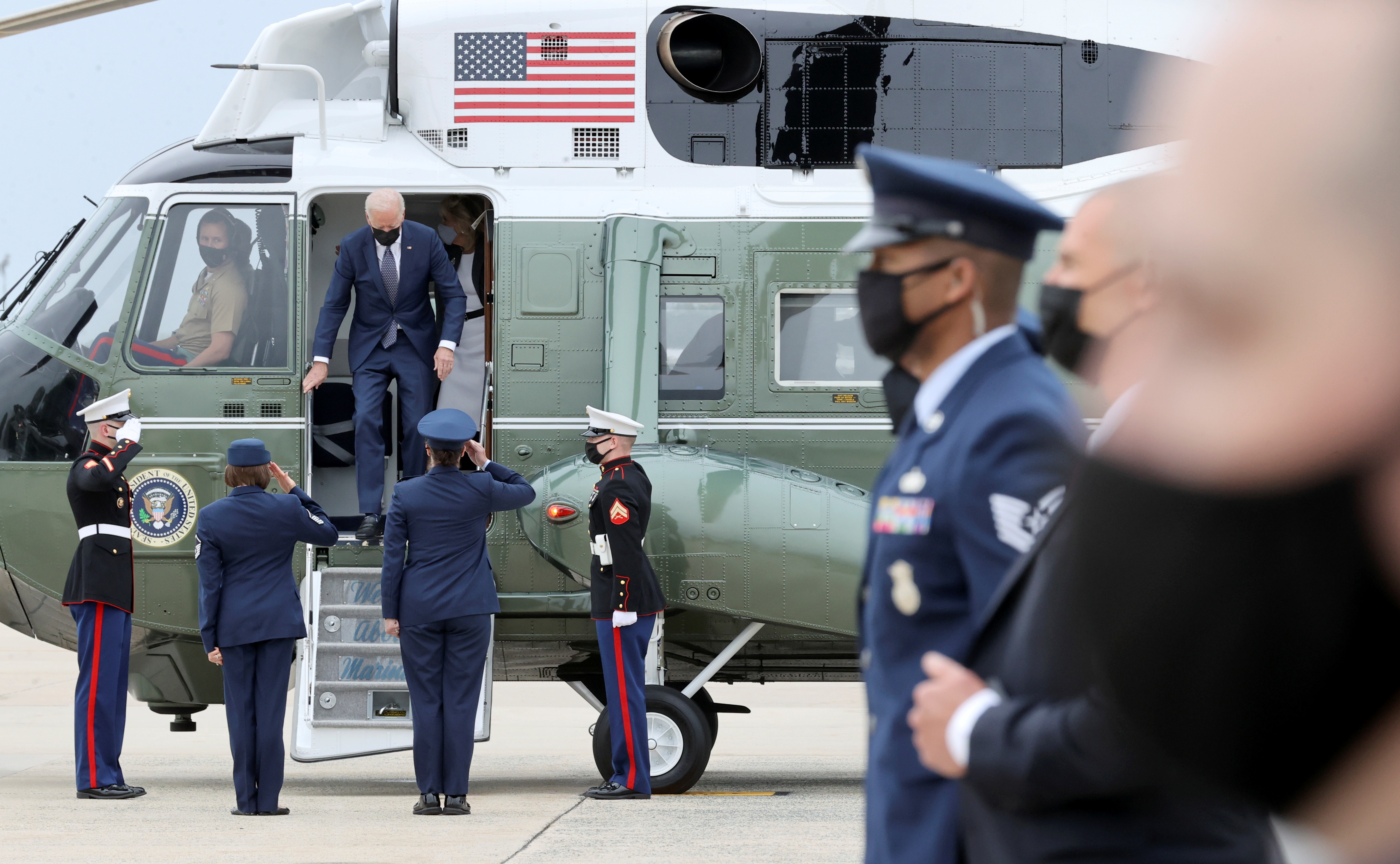 U.S. President Joe Biden and First Lady Jill Biden leave Marine One helicopter to board Air Force One for travel to Virginia from Joint Base Andrews, Maryland, U.S. May 3, 2021.  REUTERS/Jonathan Ernst