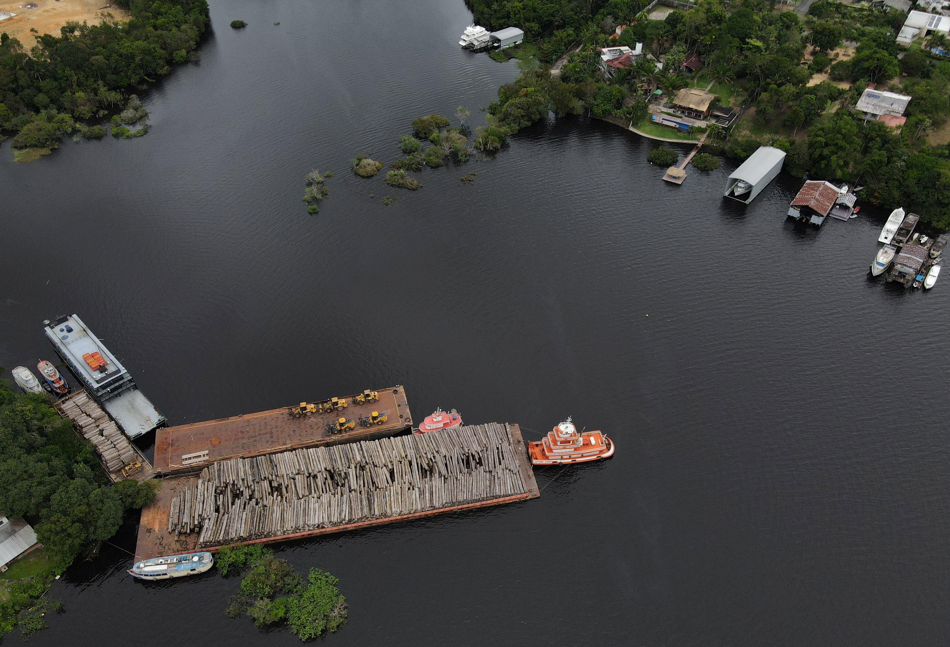 An aerial view shows wood logs on a raft at the Federal Police base in Manaus, Amazonas state, Brazil May 19, 2021. Picture taken with a drone.  REUTERS/Bruno kelly