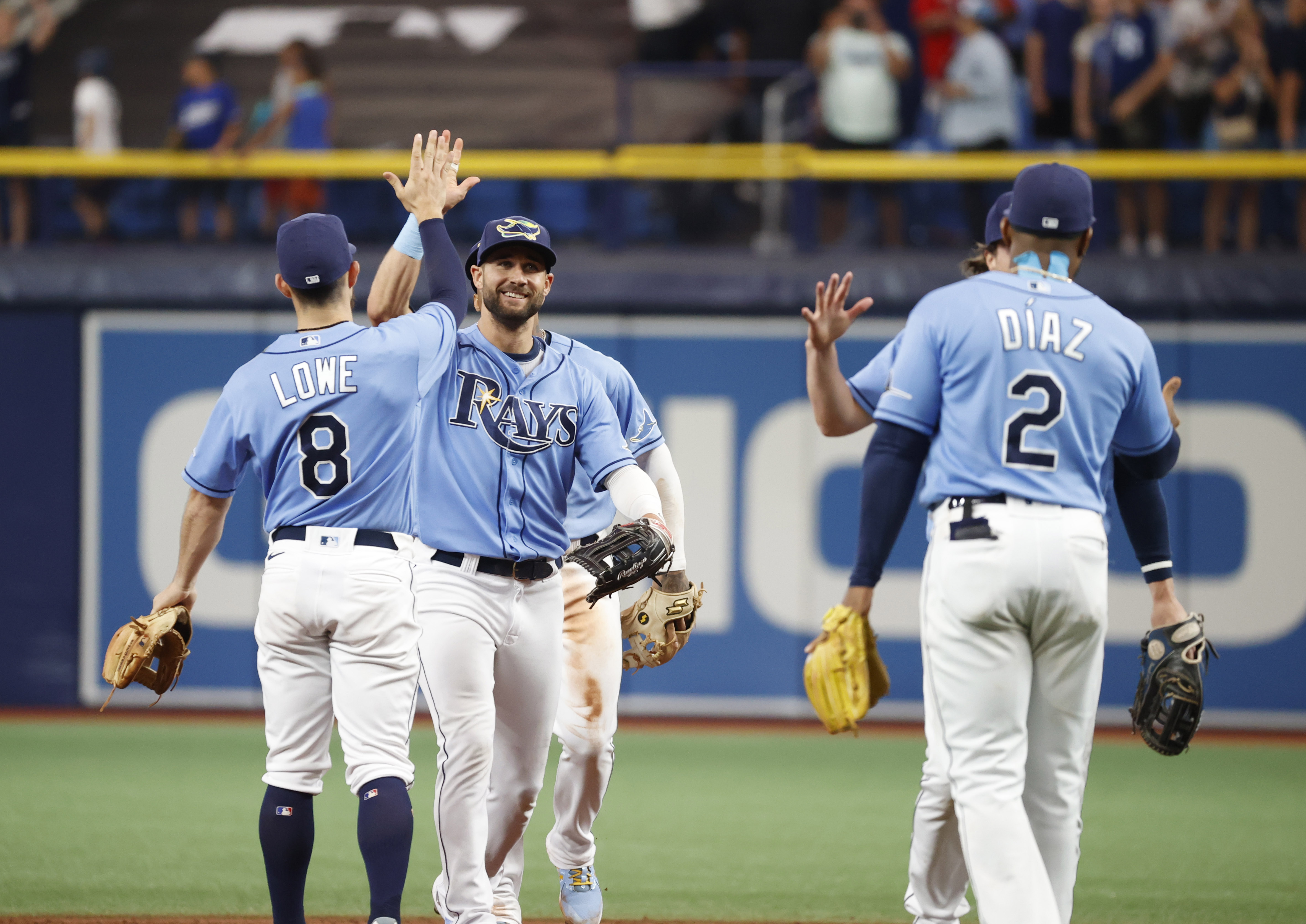 Aug 1, 2021; St. Petersburg, Florida, USA; Tampa Bay Rays center fielder Kevin Kiermaier (39) and second baseman Brandon Lowe (8) and teammates celebrate after defeating the Boston Red Sox at Tropicana Field. Mandatory Credit: Kim Klement-USA TODAY Sports