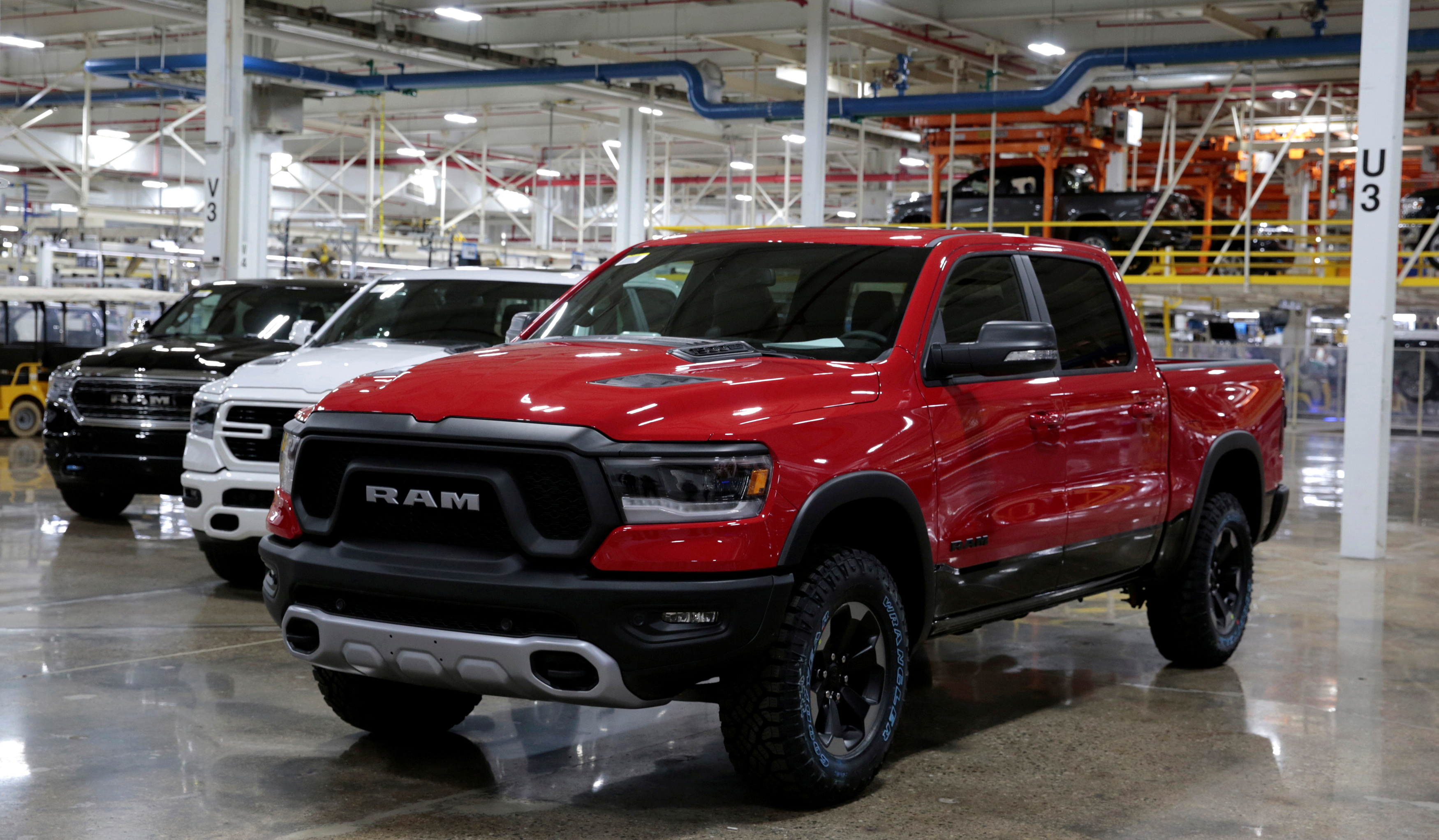 2019 Ram pickup trucks are on display at the Fiat Chrysler Automobiles (FCA) Sterling Heights Assembly Plant in Sterling Heights, Michigan, U.S., October 22, 2018. The former Fiat Chrysler is now Stellantis. REUTERS/Rebecca Cook/File Photo