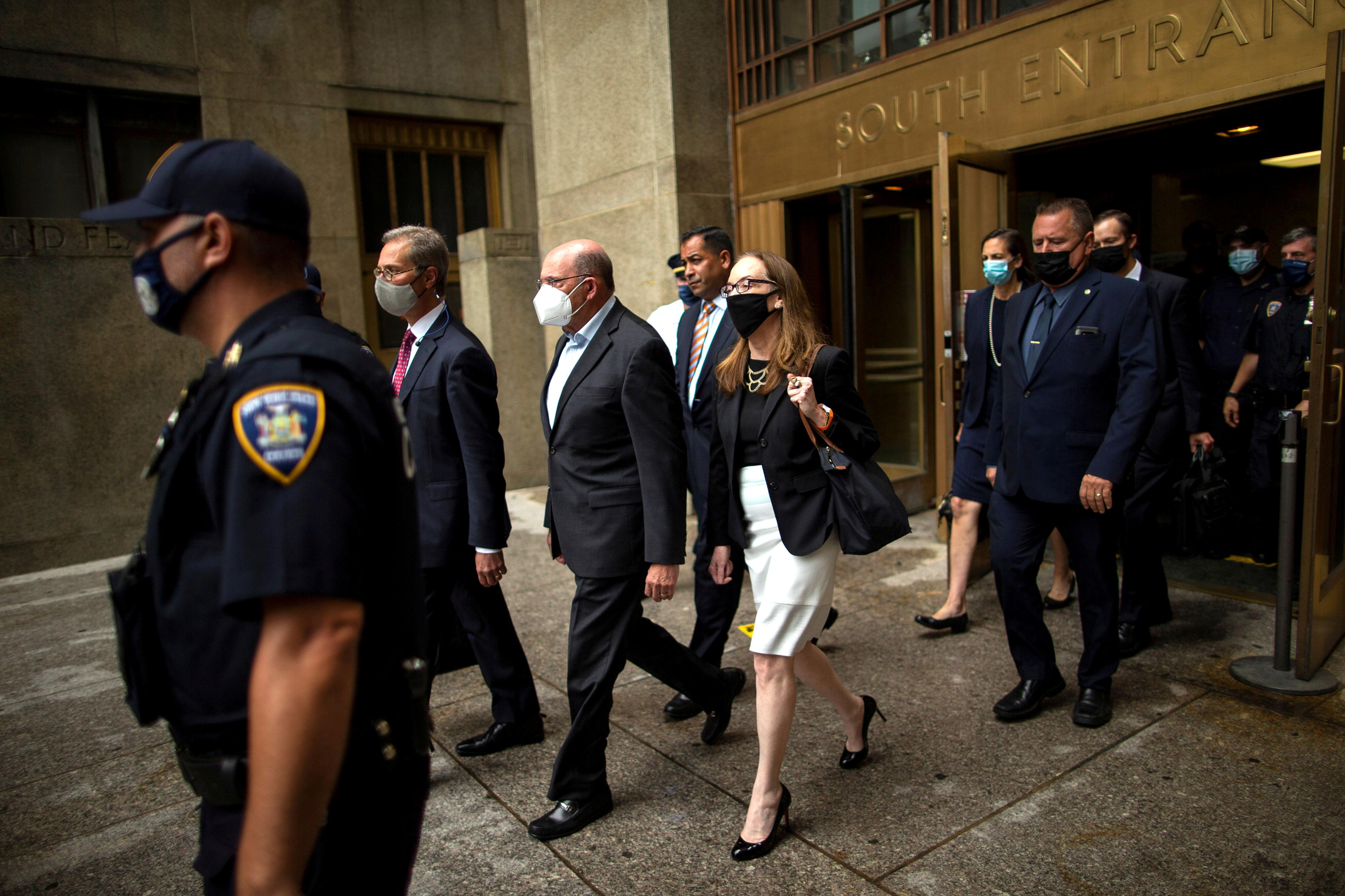 Trump Organization chief financial officer Allen Weisselberg (3rd-L) exits following his arraignment hearing in New York State Supreme Court in the Manhattan borough of New York City, New York, U.S., July 1, 2021.  REUTERS/Eduardo Munoz