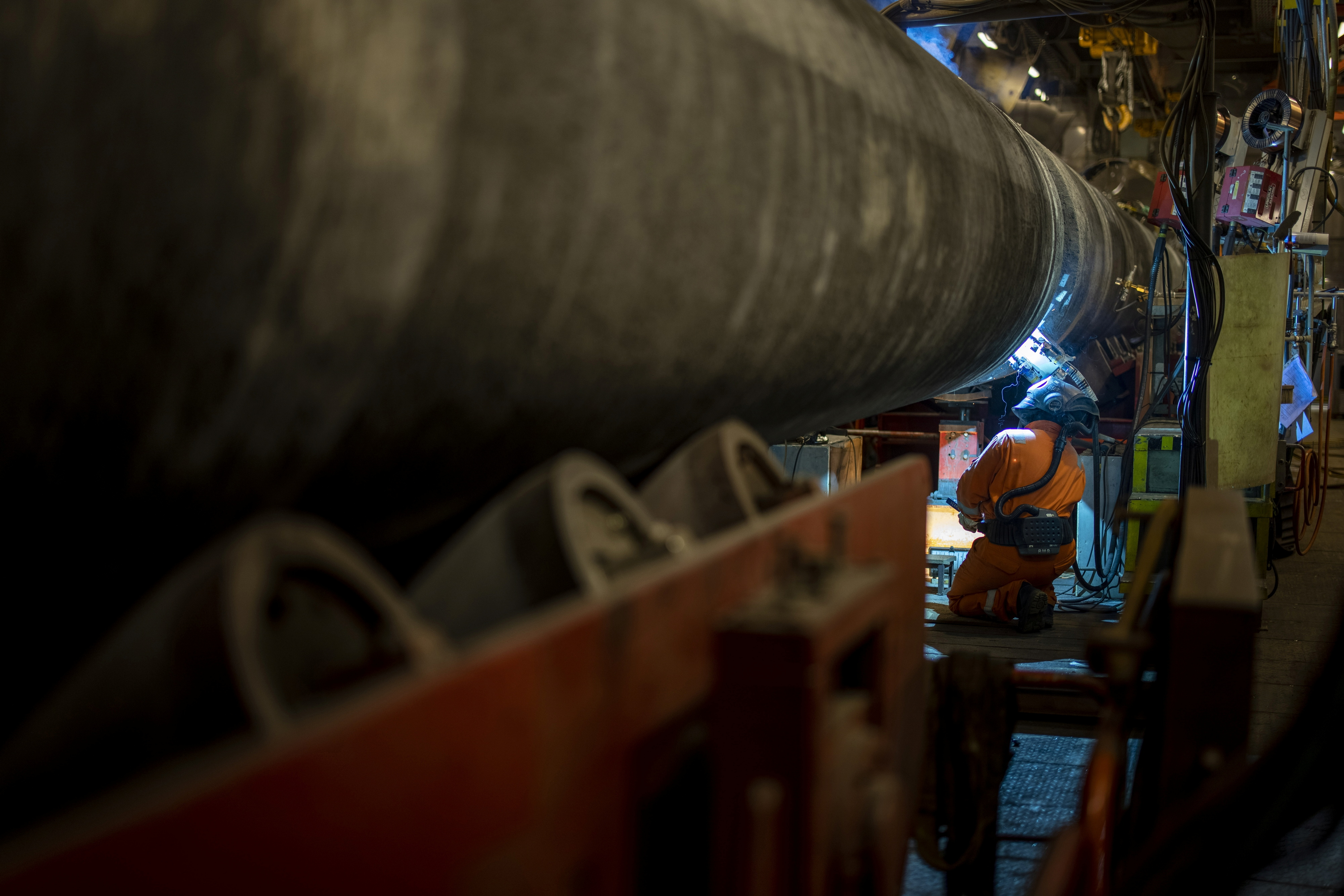 A specialist welds a pipe while finishing the construction of the Nord Stream 2 gas subsea pipeline onboard the laybarge Fortuna in German waters in the Baltic Sea, September 6, 2021. Nord Stream 2/Axel Schmidt/Handout via REUTERS