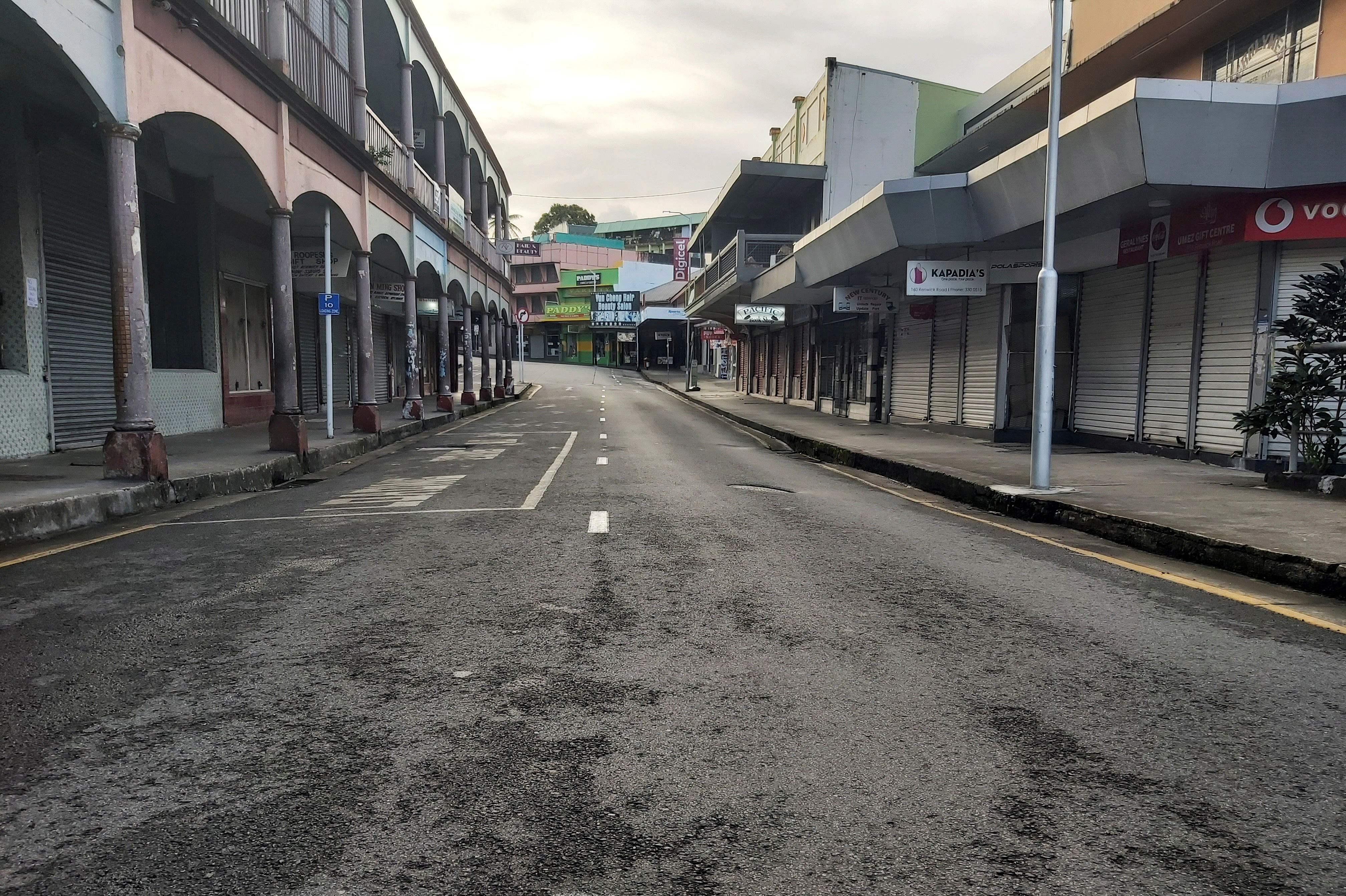 An empty downtown street is seen as shops were closed and only essential businesses and restaurants providing takeaway service remained open as an outbreak of the coronavirus disease (COVID-19) affects Suva, Fiji, June 27, 2021. Picture taken June 27, 2021.  REUTERS/David Hotchin/File Photo