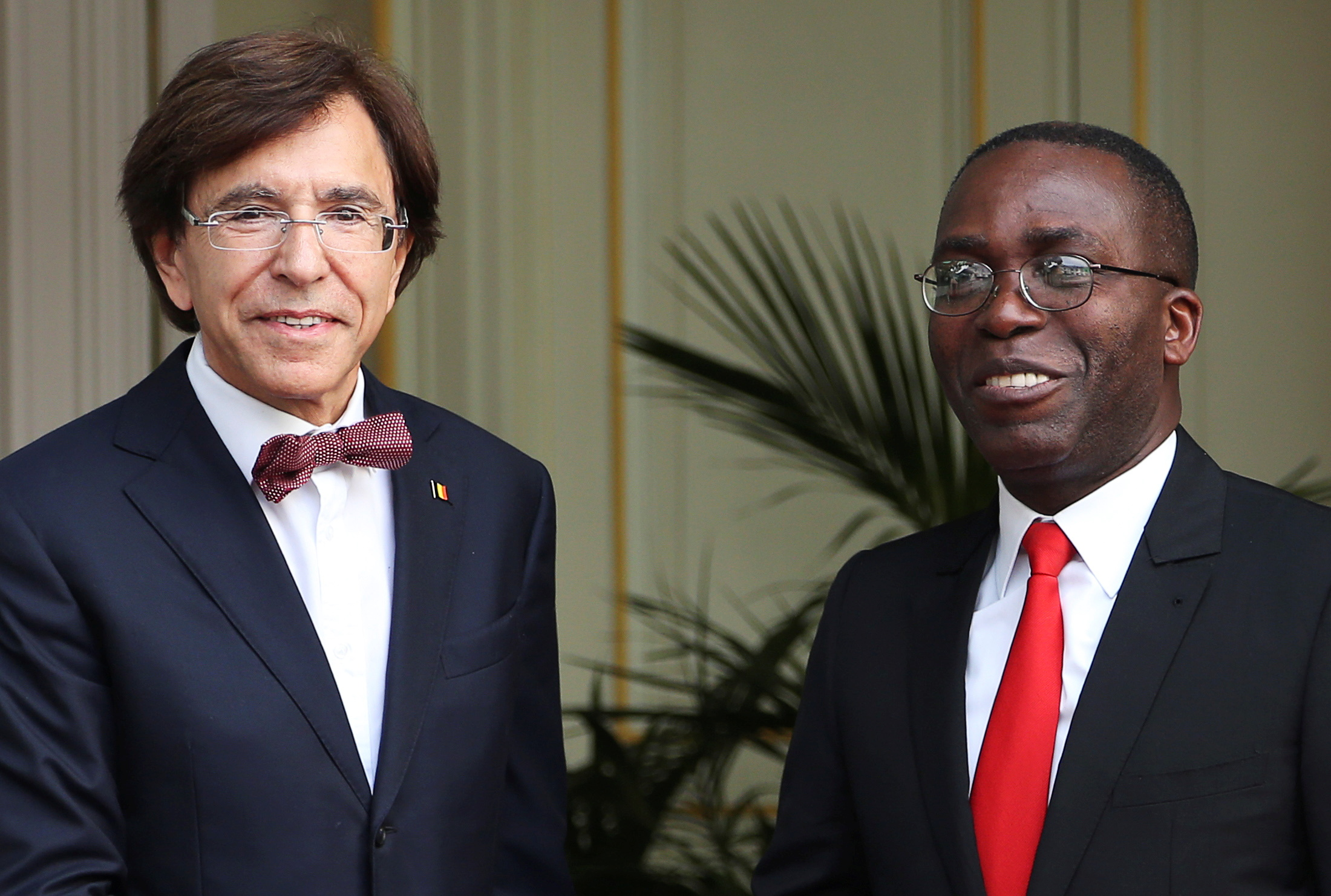 Congo's former prime minister, Matata Ponyo Mapon (right), is seen with Belgium's former prime minister, Elio Di Rupo, before a meeting in Brussels, June 24, 2014. REUTERS/Francois Lenoir/File Photo