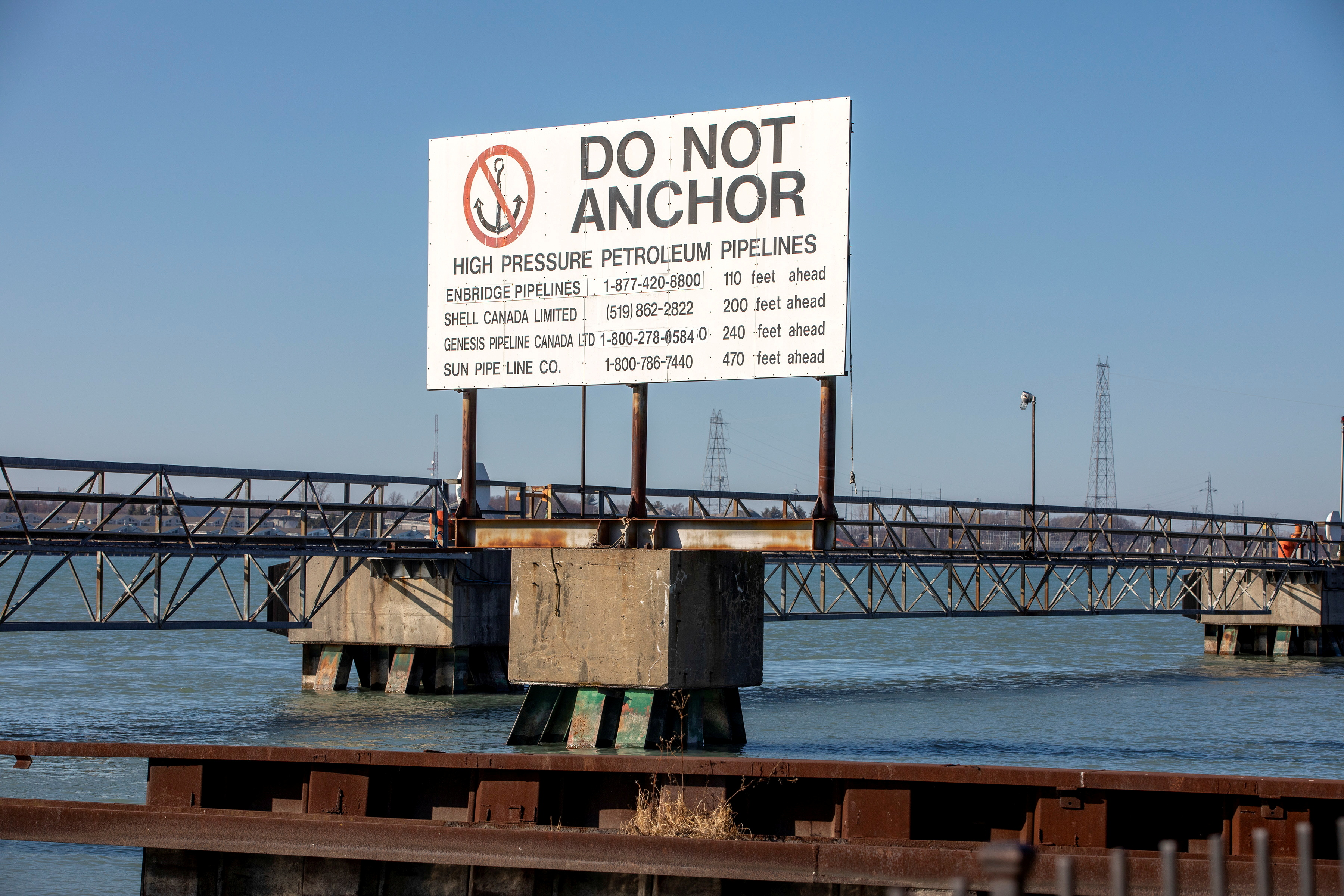 A signpost marks the presence of high pressure petroleum pipelines including Enbridge's Line 5 pipeline, which Michigan Governor Gretchen Whitmer ordered shut down in May 2021, in Sarnia, Ontario, Canada March 20, 2021. Picture taken March 20, 2021. REUTERS/Carlos Osorio/File Photo