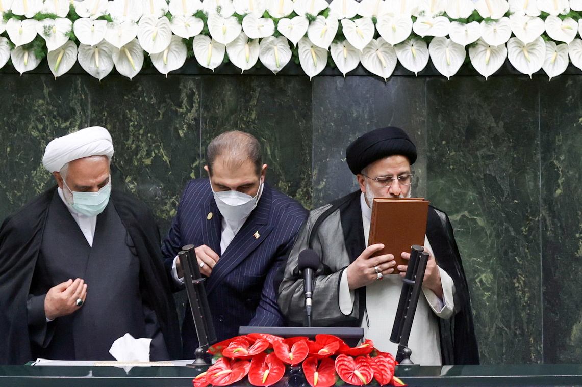 Iran's new President Ebrahim Raisi kisses the Koran during his swearing-in ceremony at the parliament in Tehran, Iran, August 5, 2021. Majid Asgaripour/WANA (West Asia News Agency)/via REUTERS