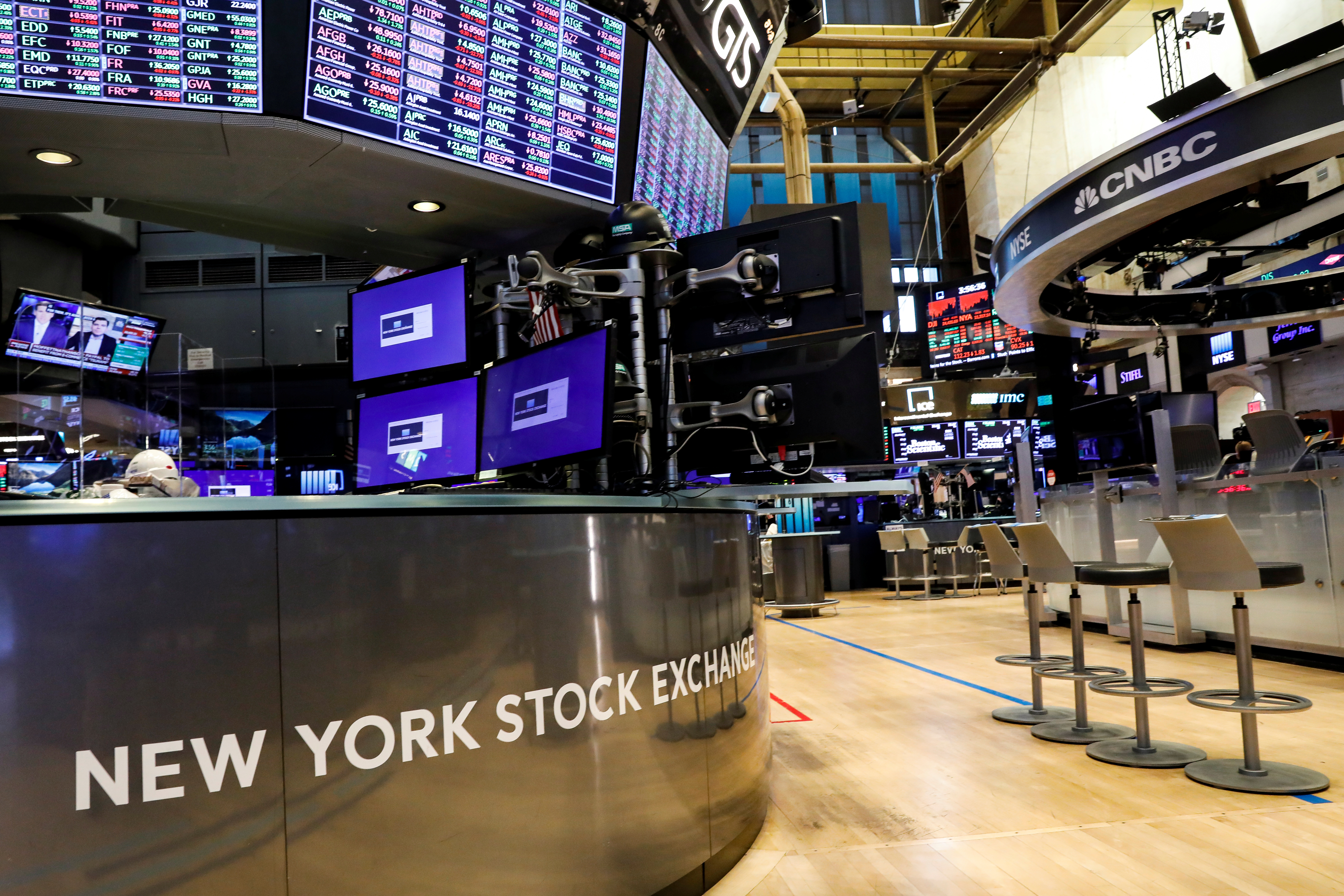 A nearly empty trading floor is seen as preparations are made for the return to trading at the New York Stock Exchange (NYSE) in New York, U.S., May 22, 2020. REUTERS/Brendan McDermid