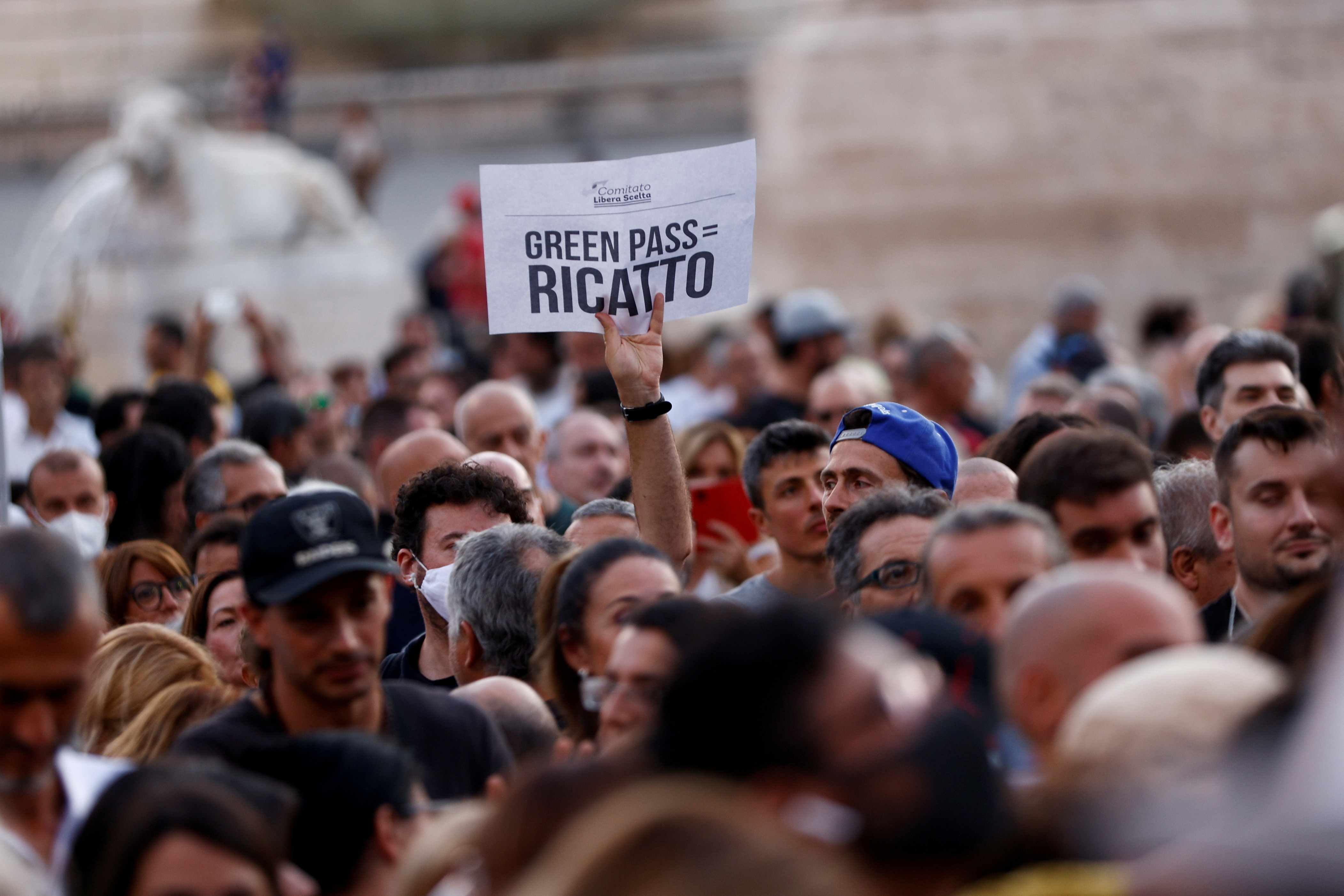 Protesters demonstrate against the Green Pass plan (health pass) in Rome, Italy, July 28, 2021. Banner reads: