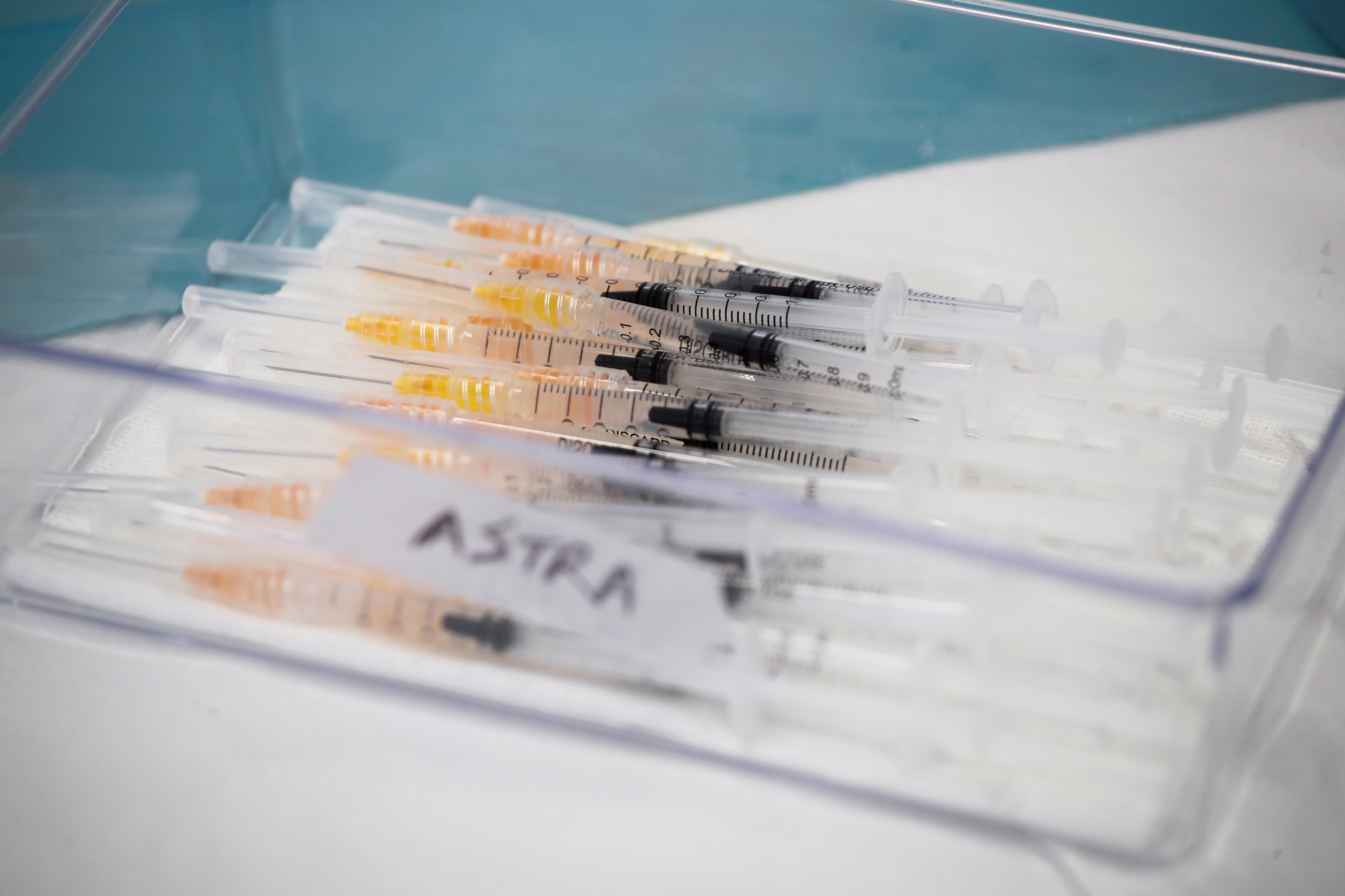 Syringes with AstraZeneca coronavirus disease (COVID-19) vaccines are prepared in Fasano Italy, April 13, 2021. REUTERS/Alessandro Garofalo