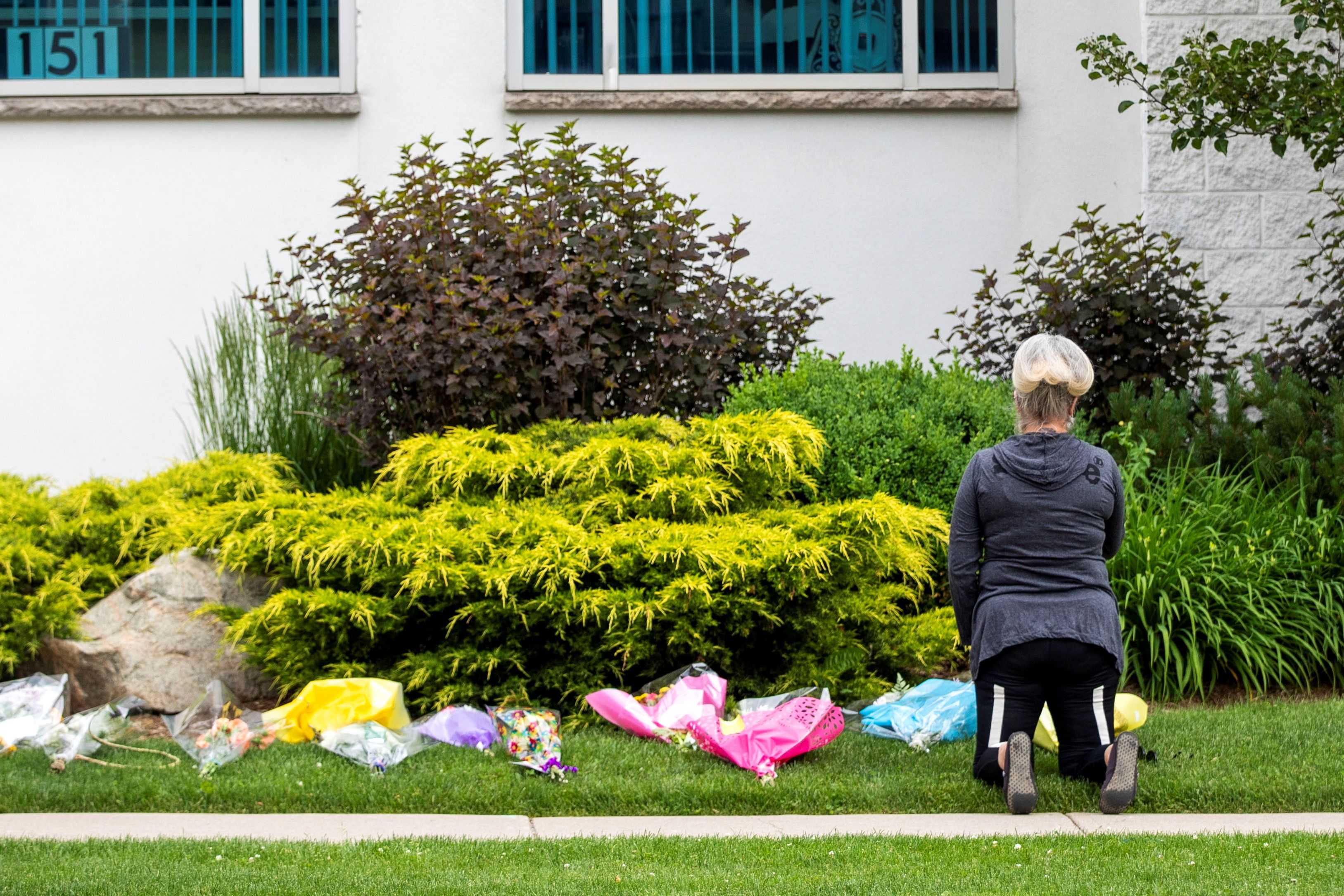 A woman prays at the London Muslim Mosque, which is located about 500 metres from where police arrested the suspect of a hate-motivated attack that killed four members of a Muslim family, in London, Ontario, Canada June 8, 2021. REUTERS/Carlos Osorio