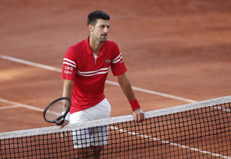 Tennis - French Open - Roland Garros, Paris, France - June 13, 2021 Serbia's Novak Djokovic reacts after winning the final against Greece's Stefanos Tsitsipas REUTERS/Benoit Tessier
