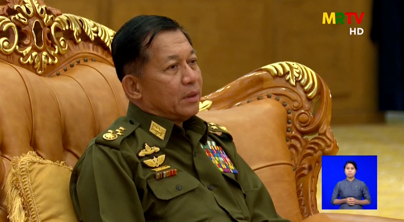 A screen grab from Myanmar state television broadcast from February 3, 2021 shows General Min Aung Hlaing speaking during a meeting. MRTV/Handout via REUTERS