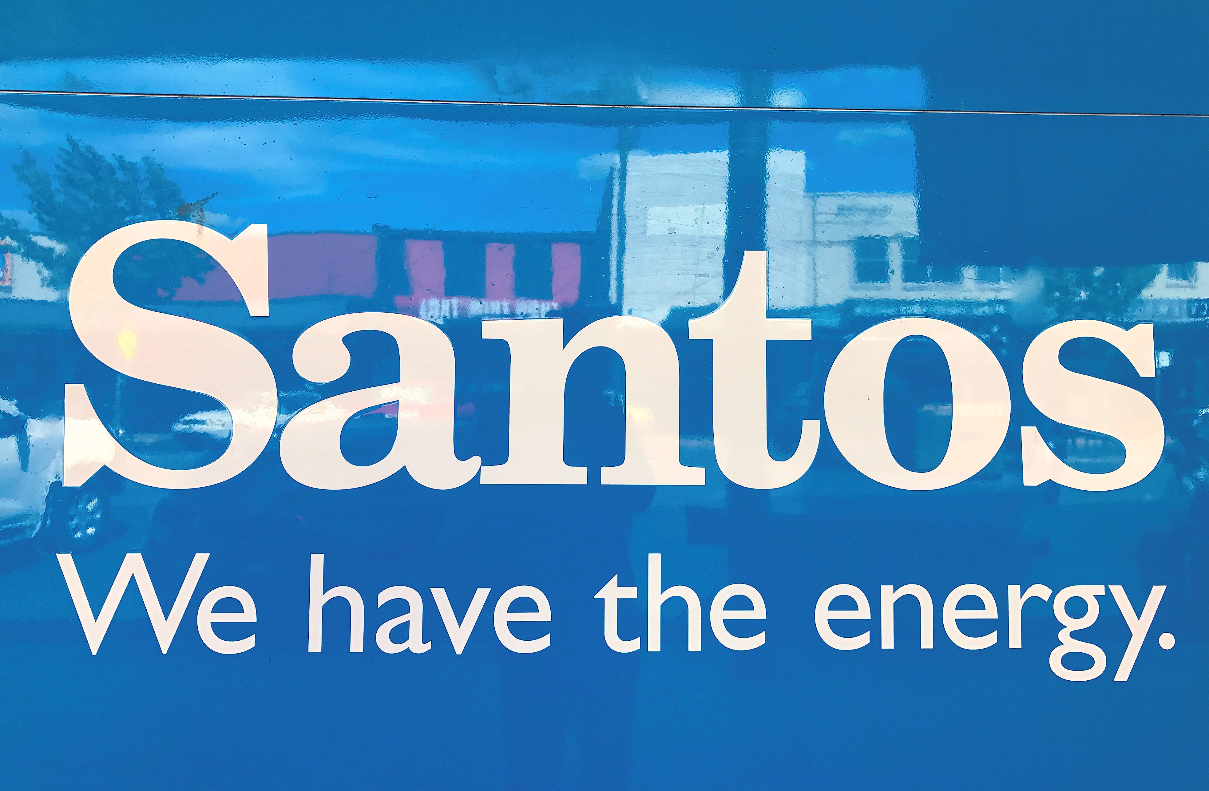 A sign for Santos Ltd is displayed on the front of the company's office building in the rural township of Gunnedah, located in north-western New South Wales in Australia, March 9, 2018. Picture taken March 9, 2018.   REUTERS/David Gray