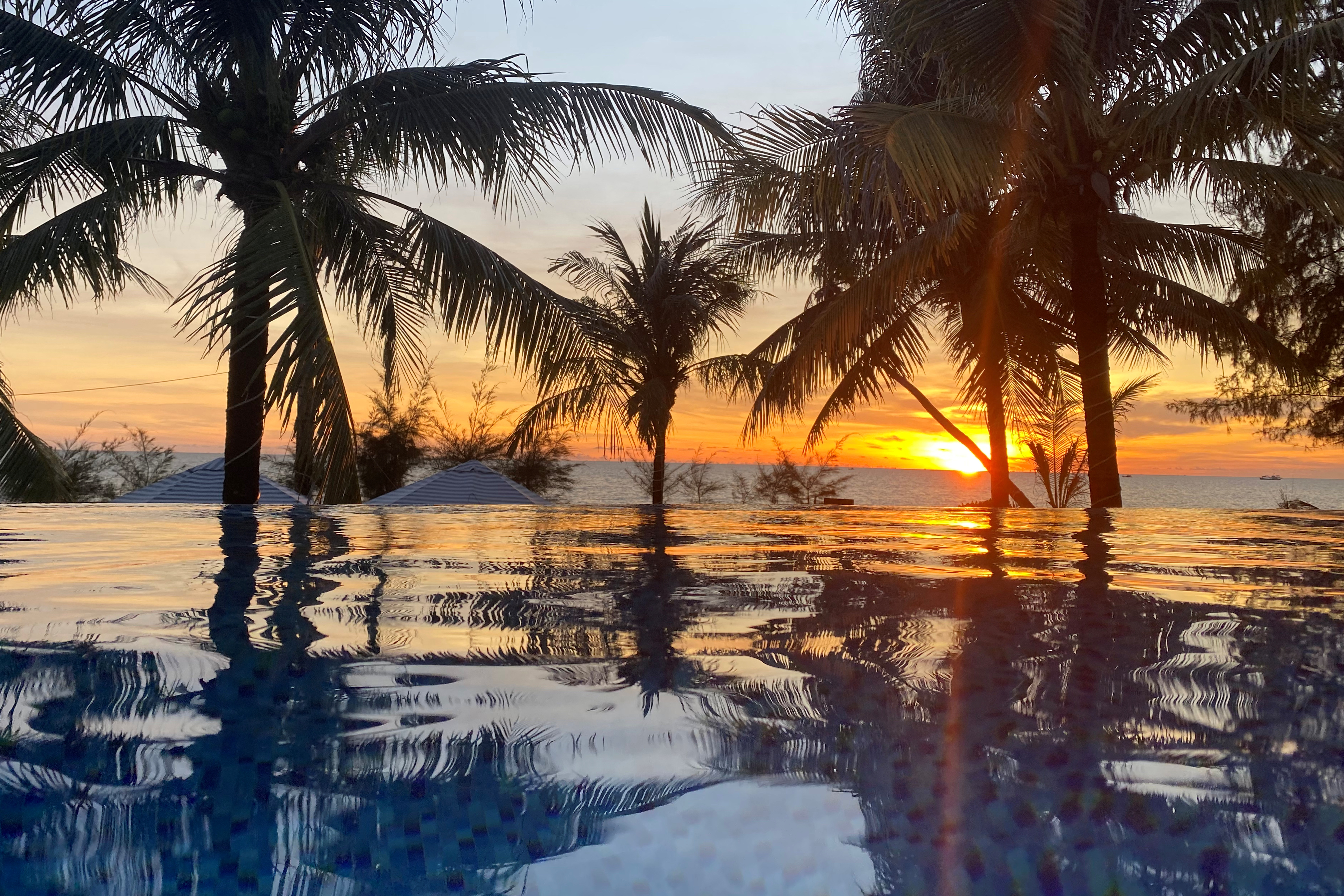 A sunset is seen in a resort after the Vietnamese government eased the lockdown following the coronavirus disease (COVID-19) outbreak, in Phu Quoc island, Vietnam May 8, 2020. REUTERS/James Pearson