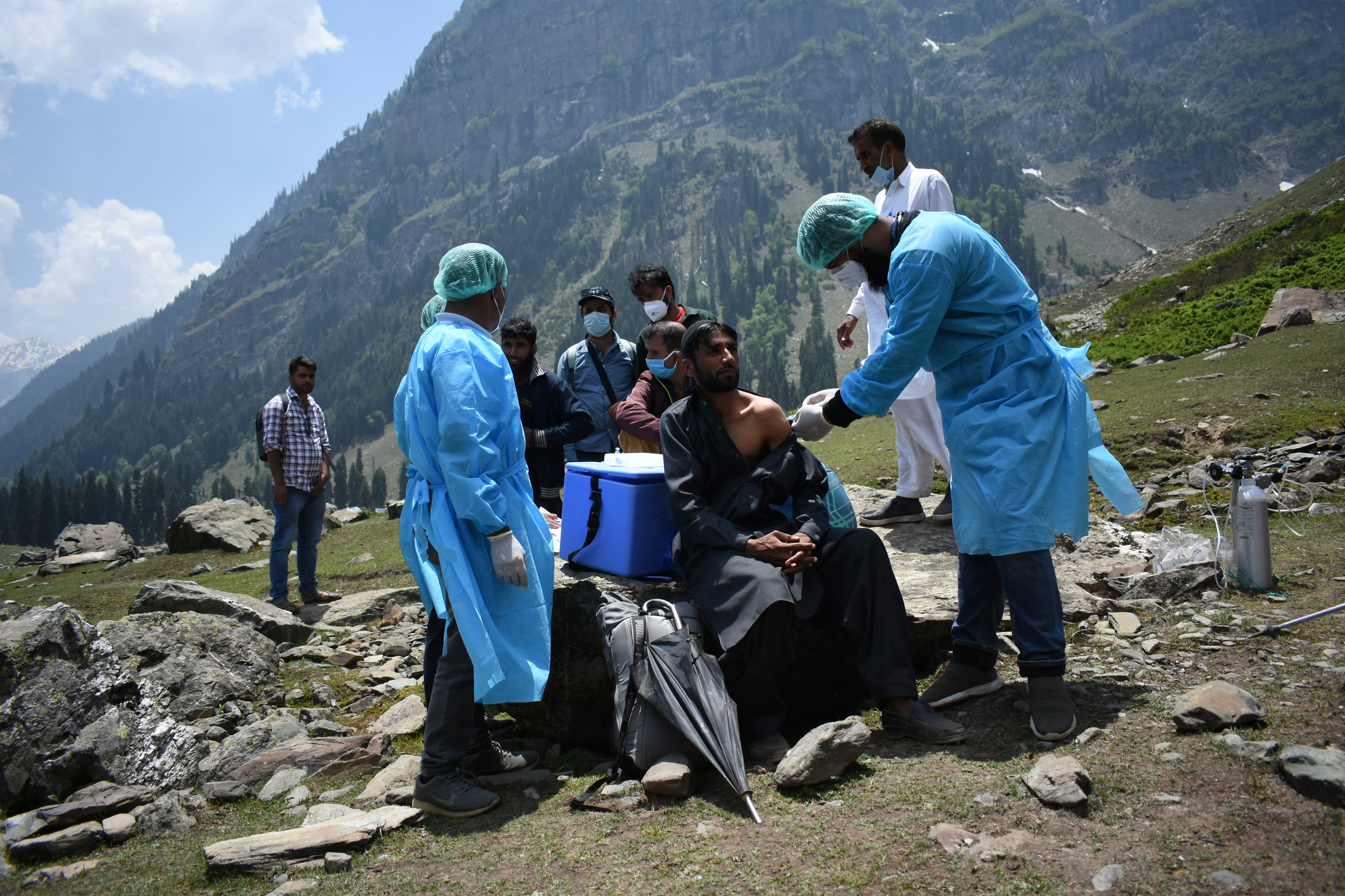 A healthcare worker administers a dose of COVISHIELD, a coronavirus disease (COVID-19) vaccine manufactured by Serum Institute of India, to a shepherd man during a vaccination drive at Lidderwat near scenic Pahalgam in south Kashmir's Anantnag district, June 10, 2021. Picture taken June 10, 2021. REUTERS/Sanna Irshad Mattoo