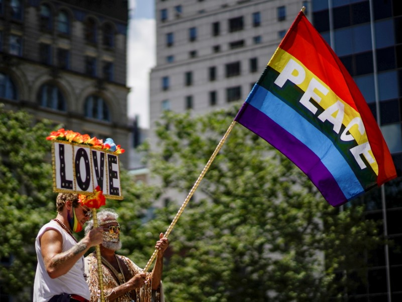 Demonstrators hold a sign and a rainbow Pride flag at a joint LGBTQ and Black Lives Matter march in New York City, New York, U.S. June 28, 2020. REUTERS/Eduardo Munoz/File Photo