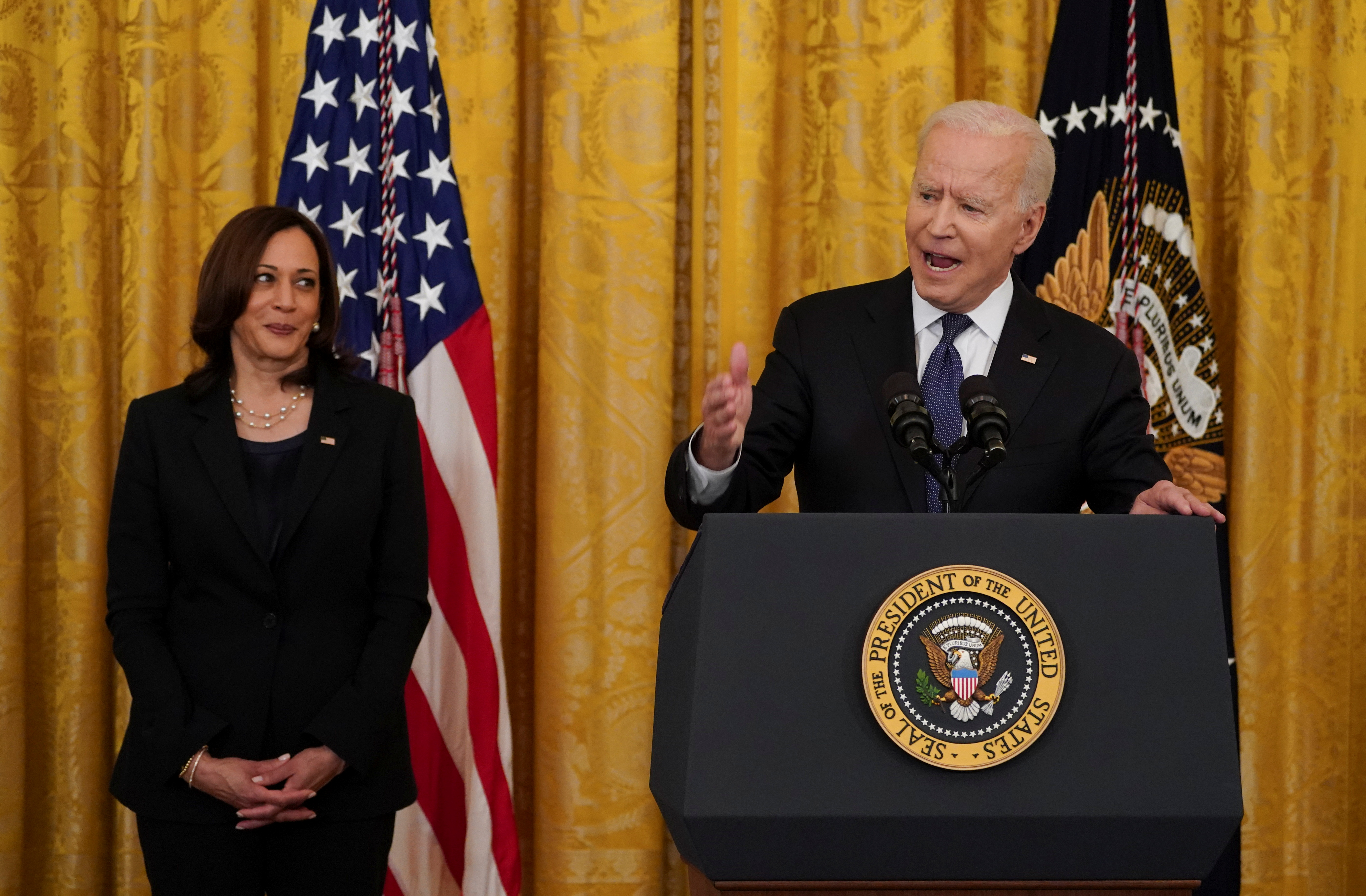 U.S. President Joe Biden speaks next to U.S. Vice President Kamala Harris before signing the COVID-19 Hate Crimes Act into law, in the East Room at the White House in Washington, U.S., May 20, 2021. REUTERS/Kevin Lamarque